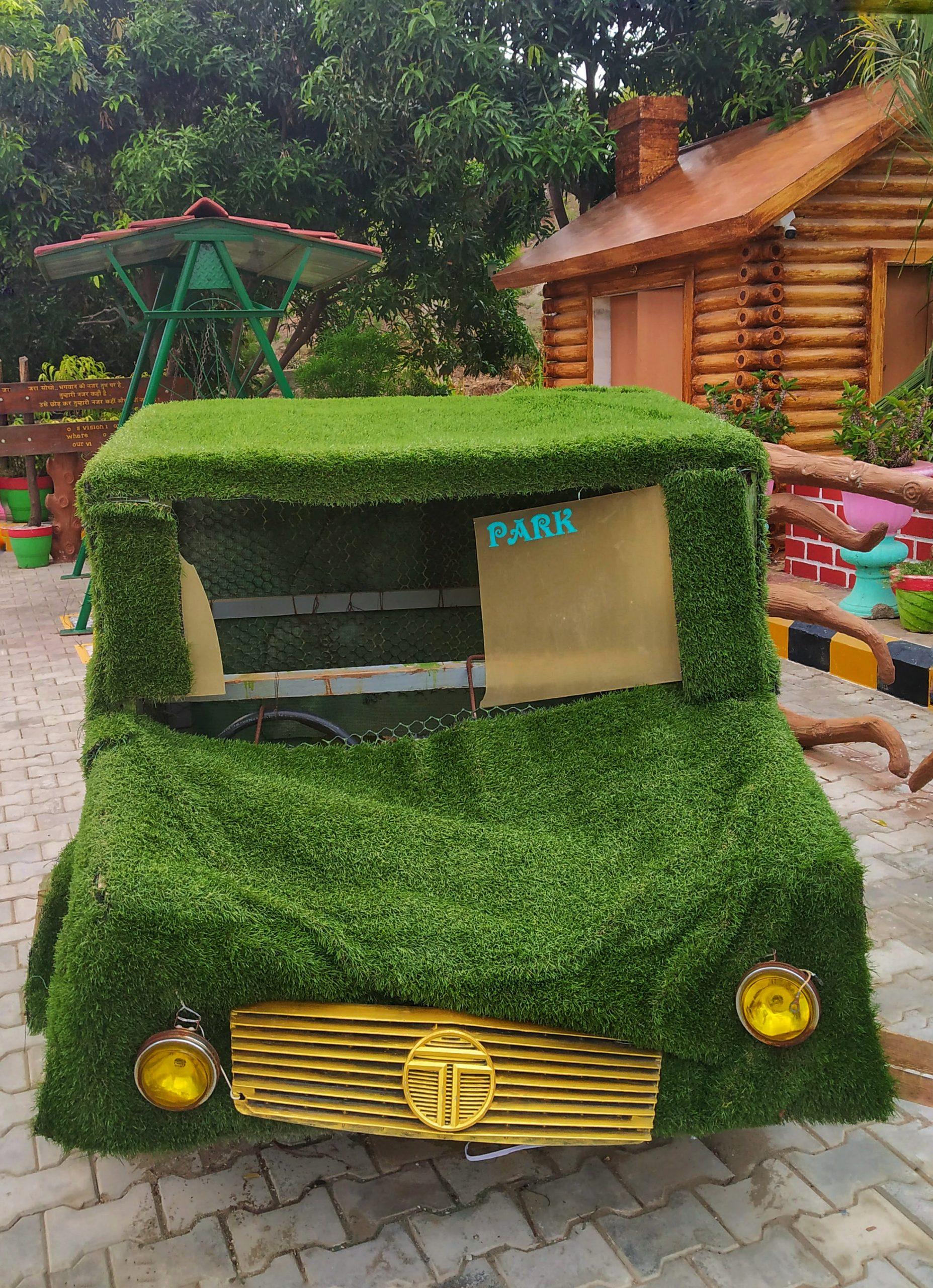 A showpiece car in a garden