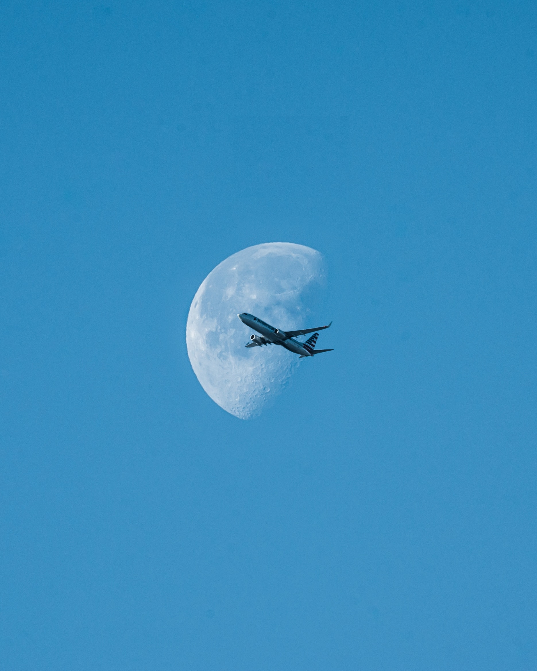 Aero plane in the sky against the moon