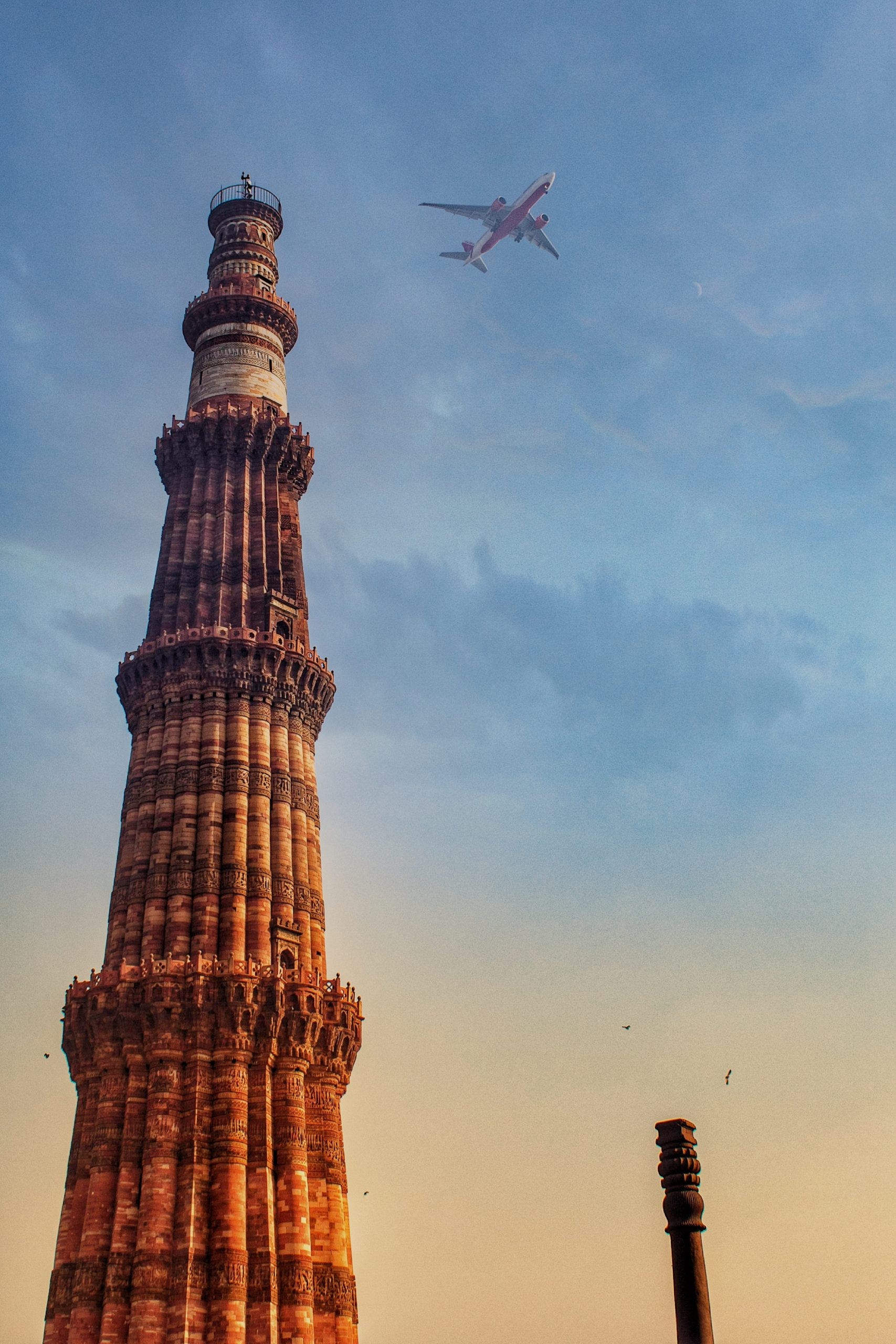 Airplane over Qutub Minar Monument