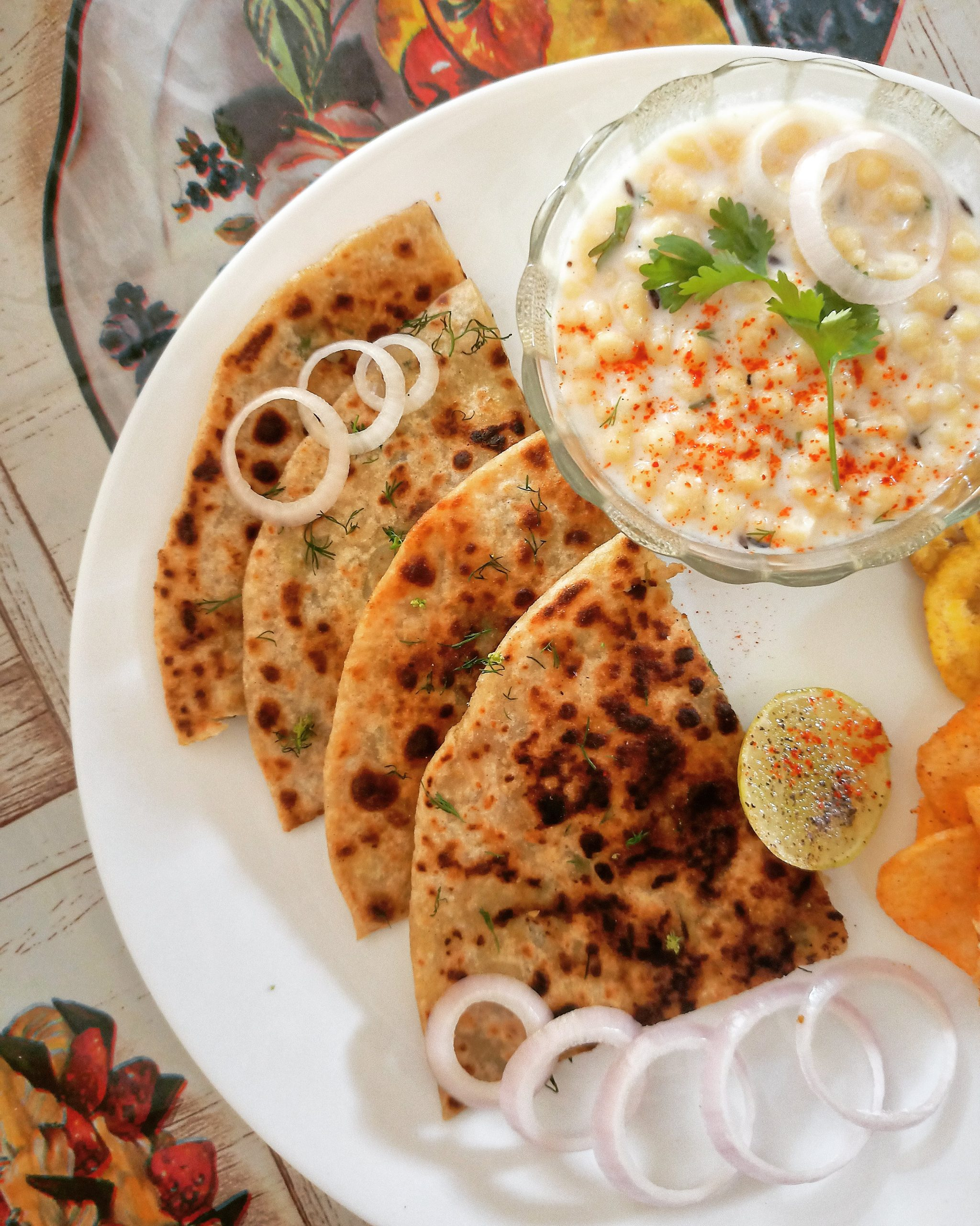 Aloo paratha with curd and salad
