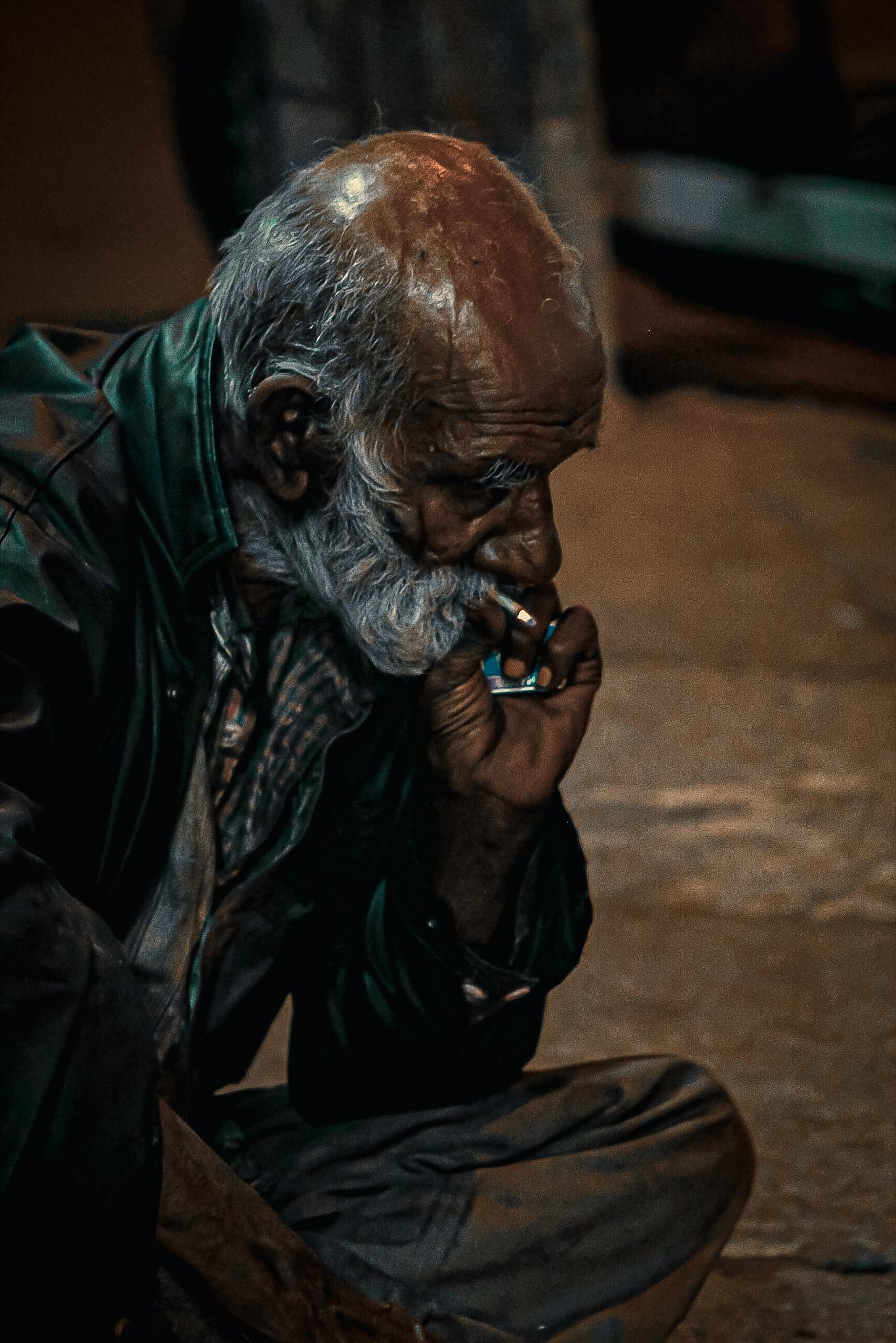 An old man smoking