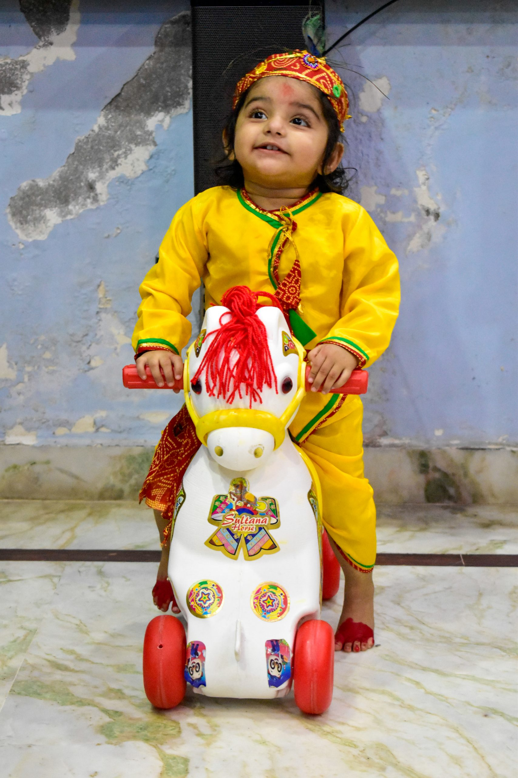 Baby on toy horse