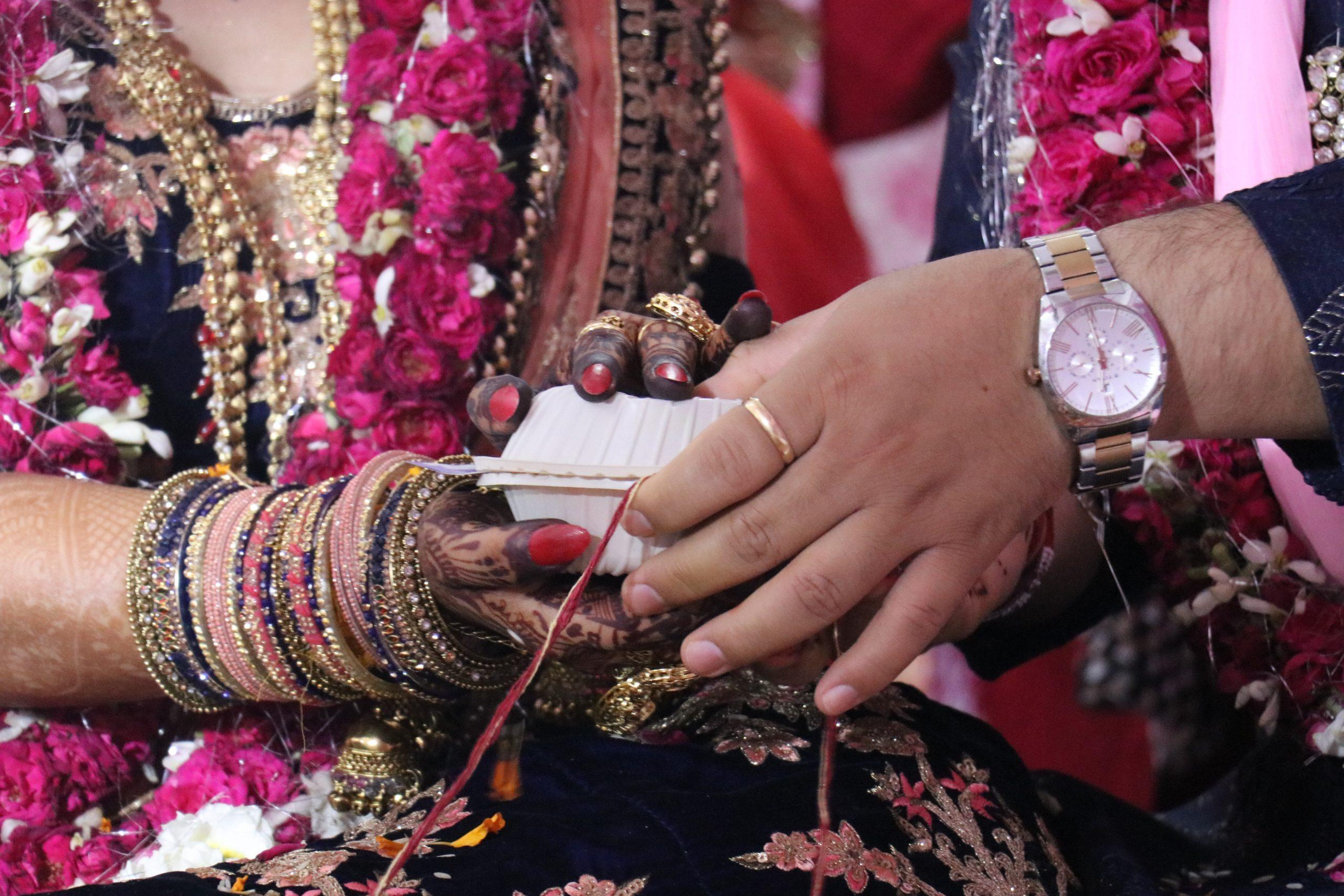 Indian wedding couple's hand