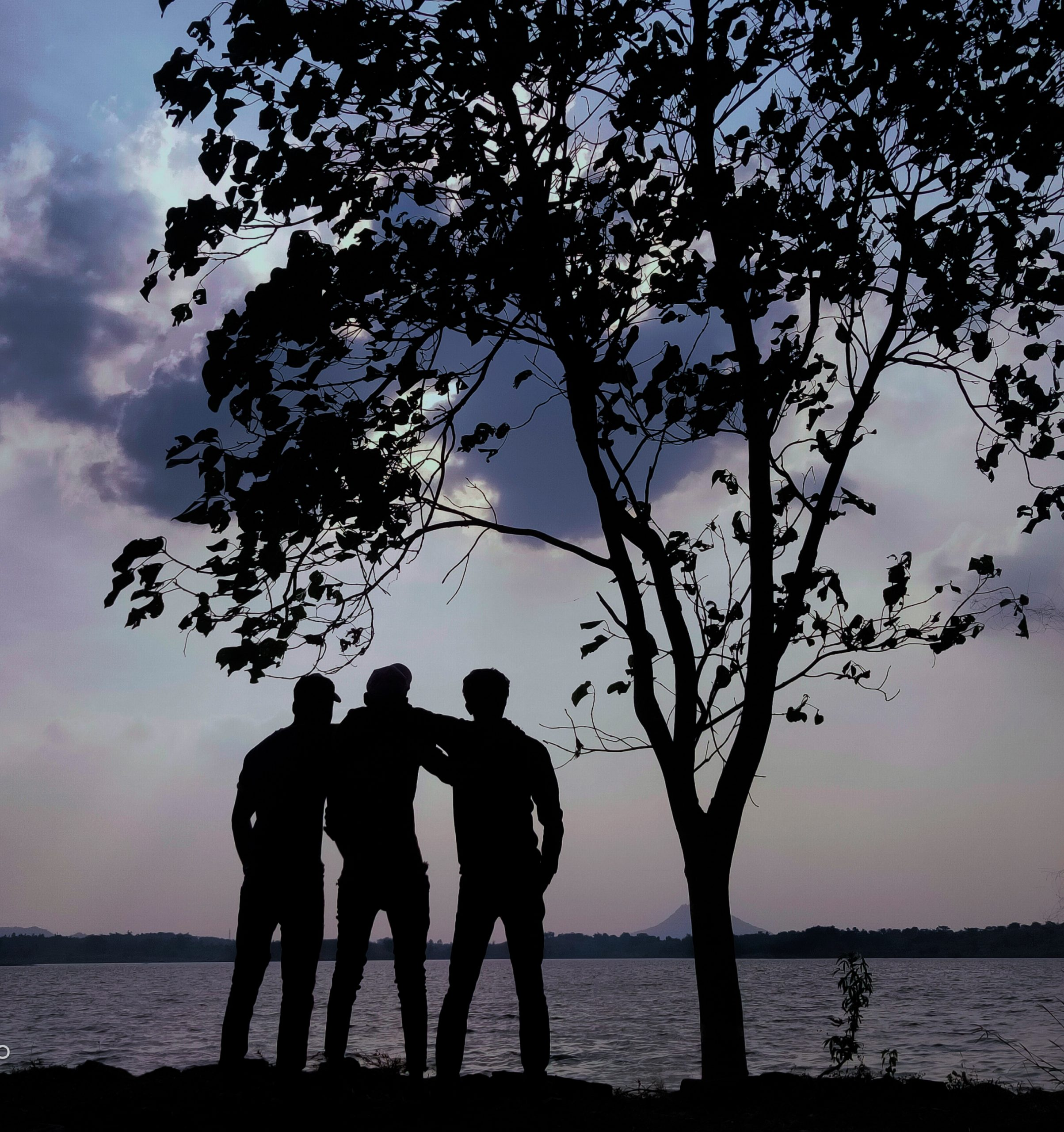 Silhouette of three friends