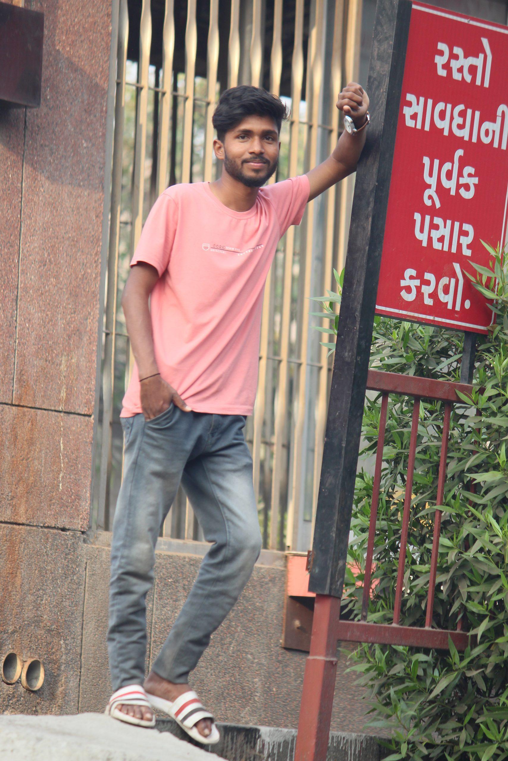 Boy posing near the caution board