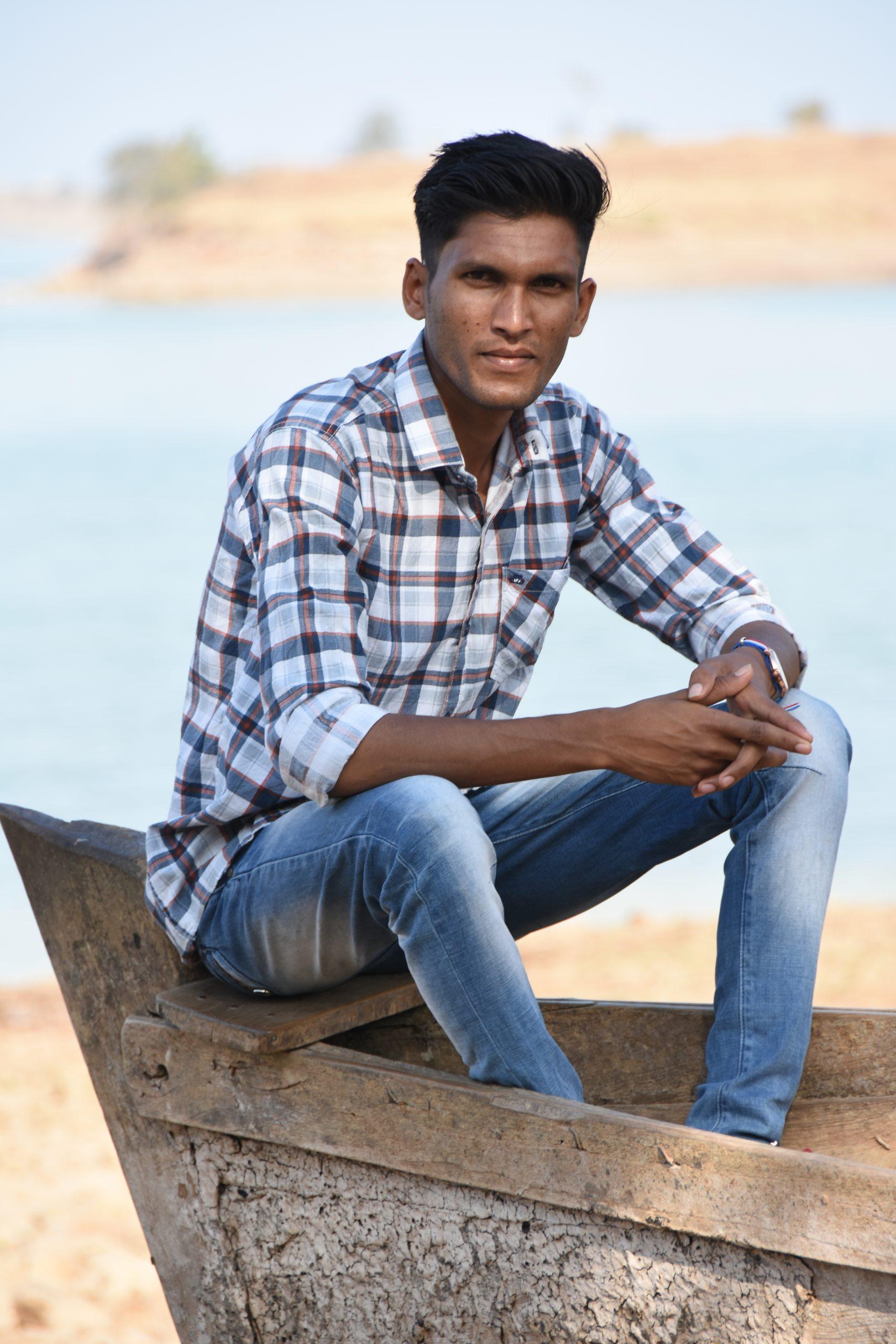 Boy posing in the boat