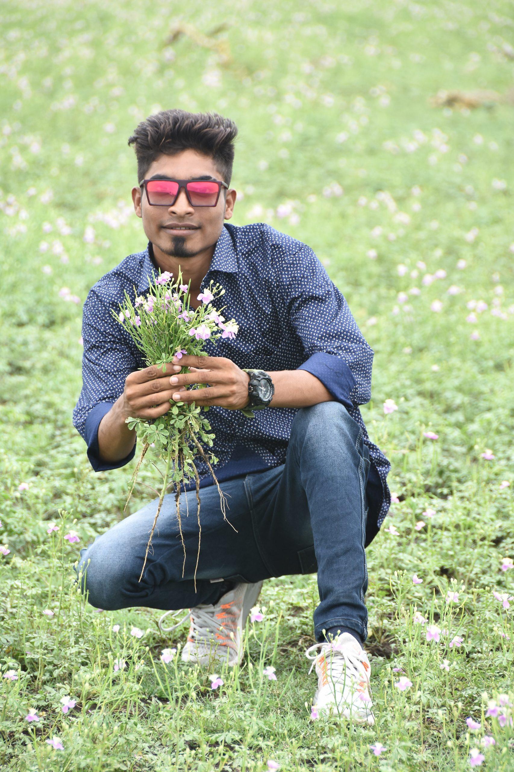 Boy posing with flowers in farm