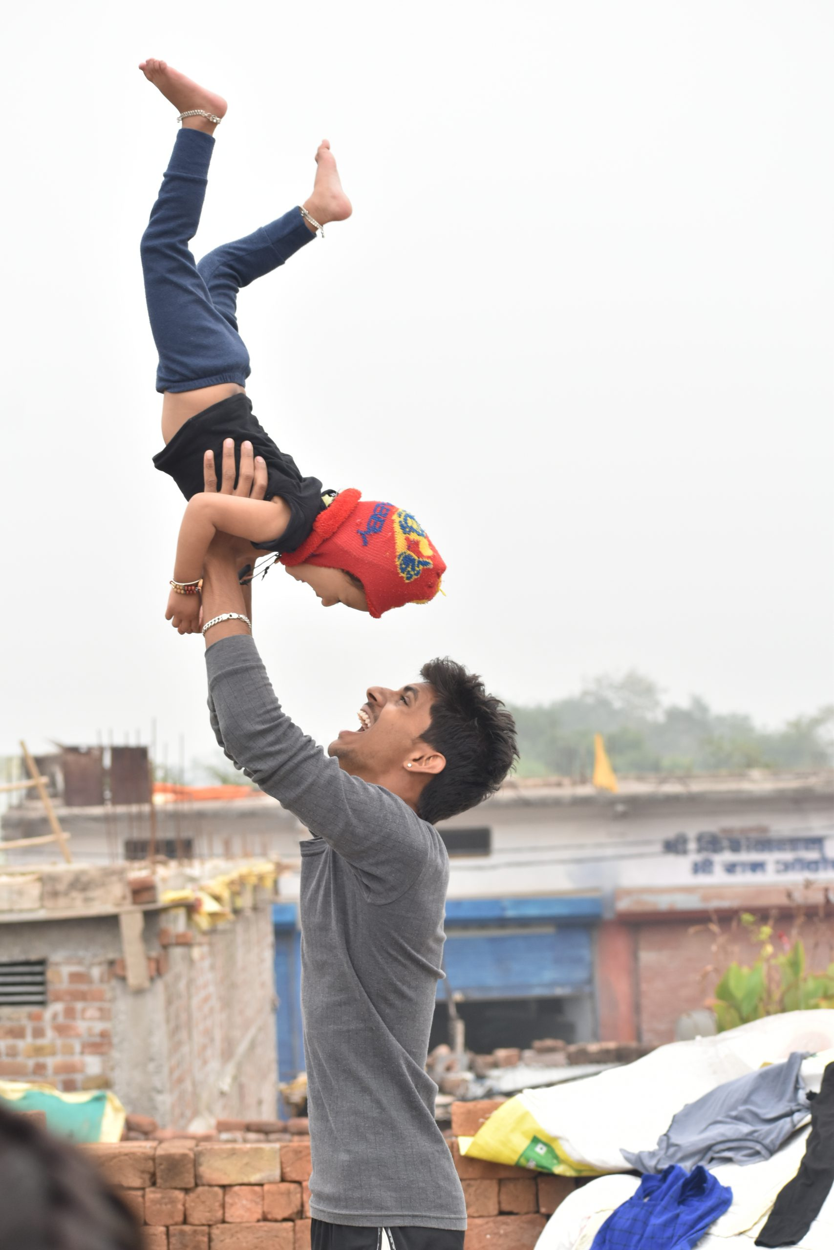 Boy playing with kid