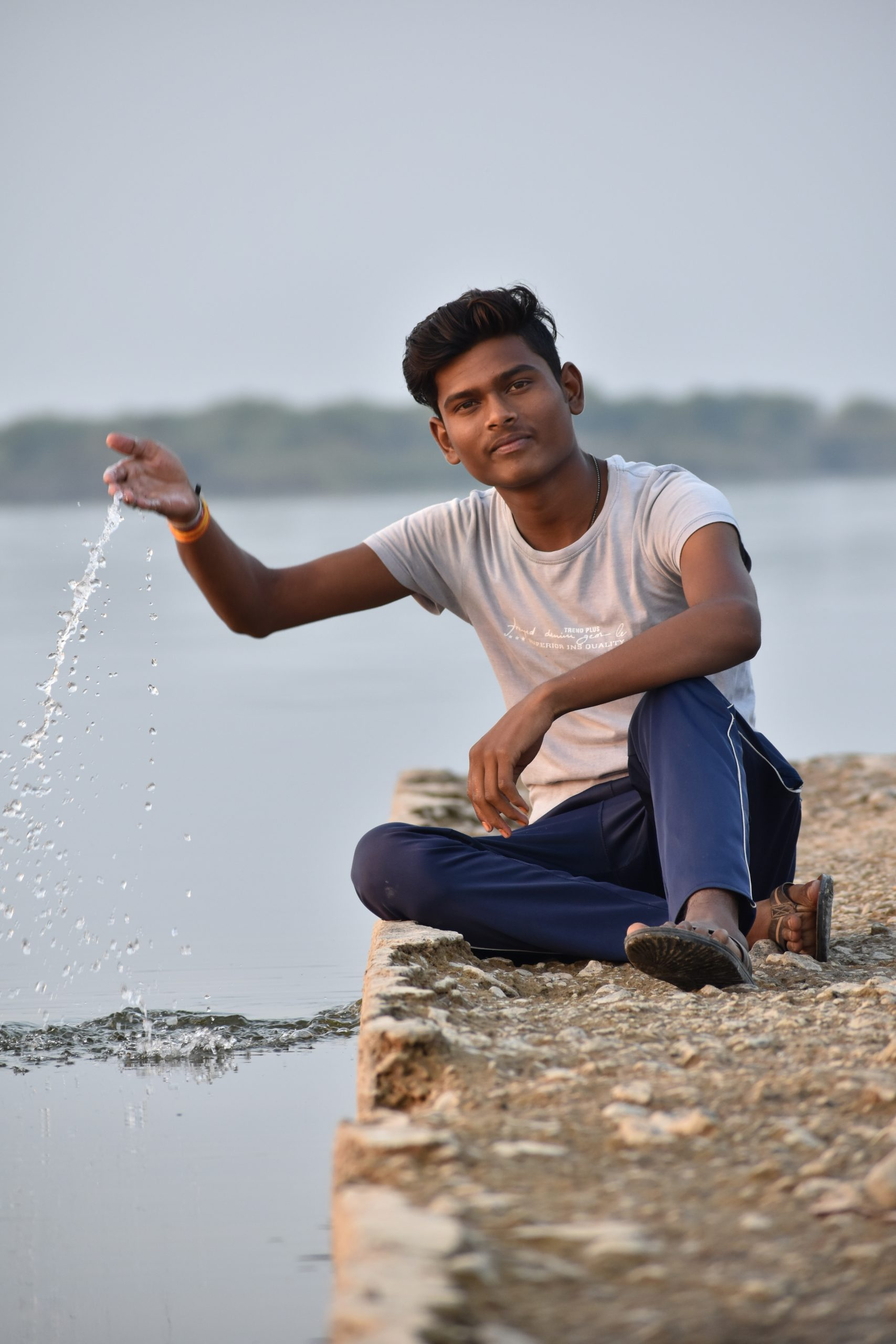 Boy playing with water near the river