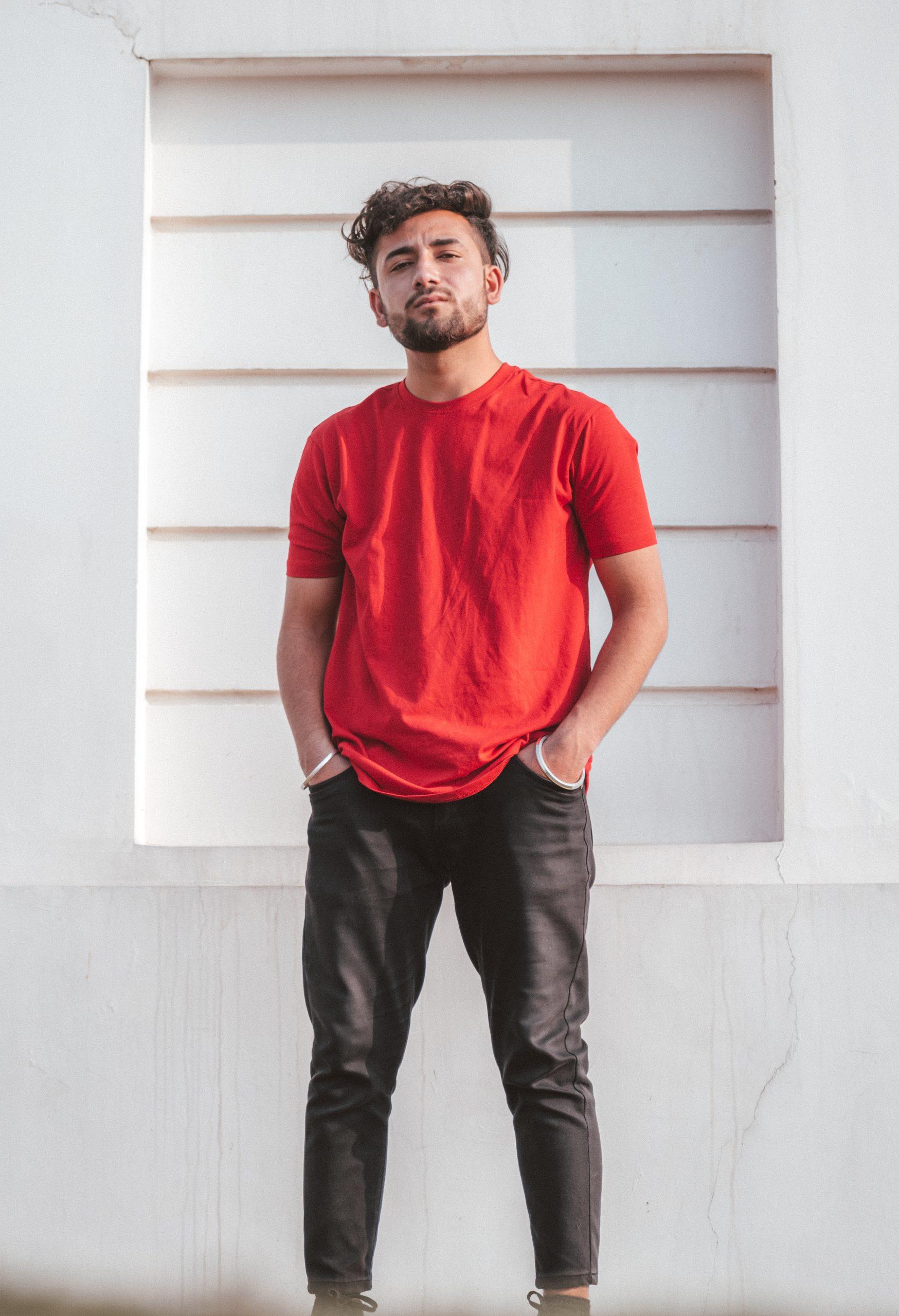 Boy posing against the wall