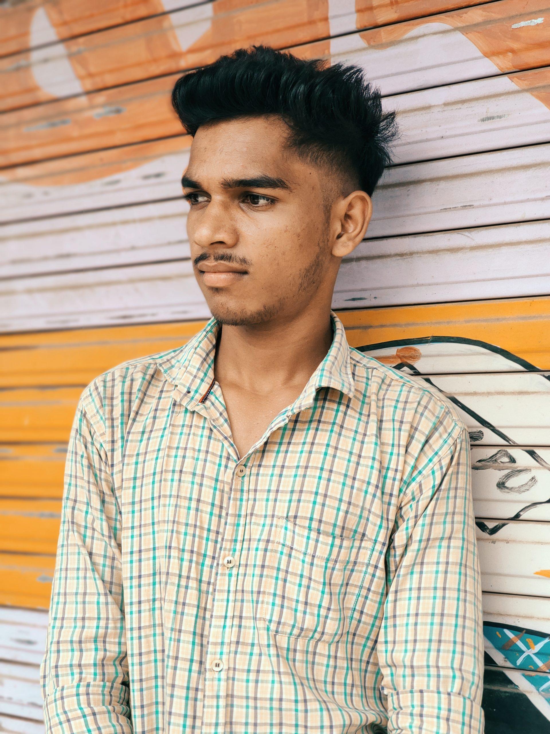 Boy posing in front of shutter