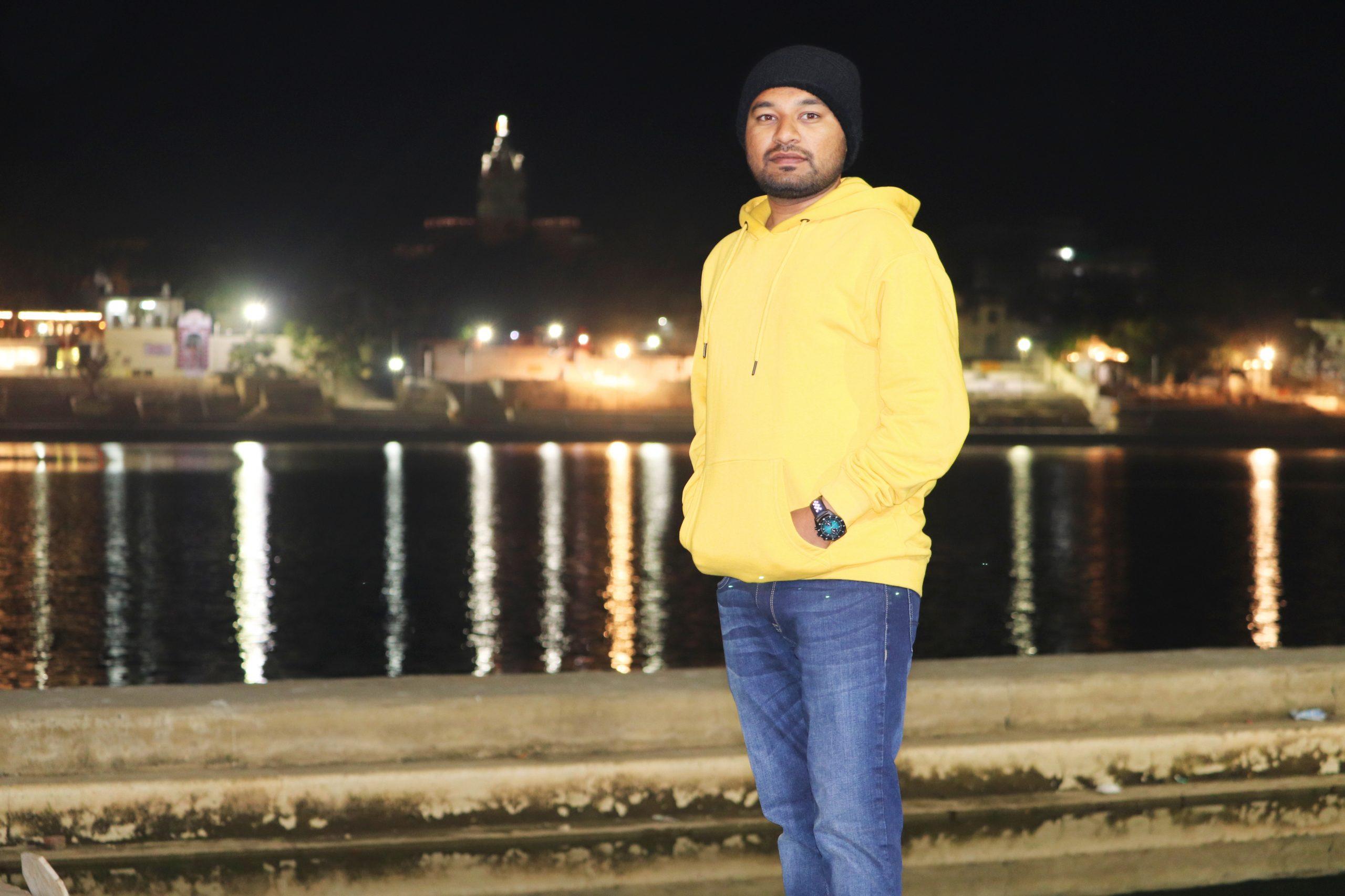Boy posing in night light