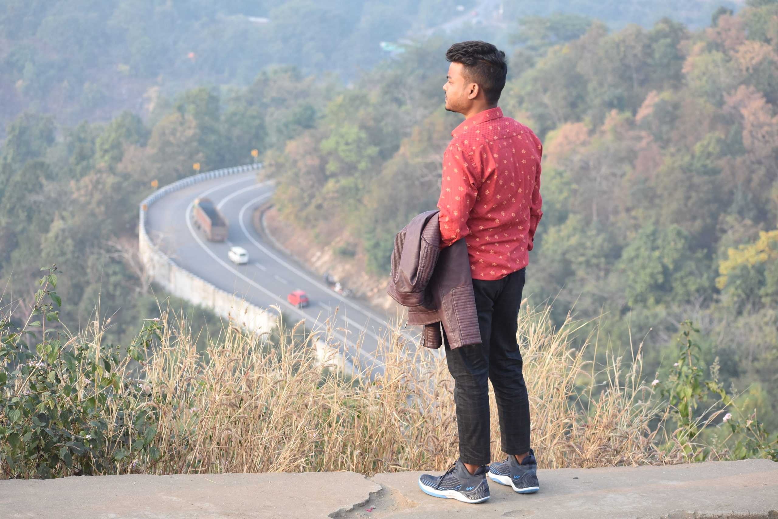 Boy posing in the hilly area