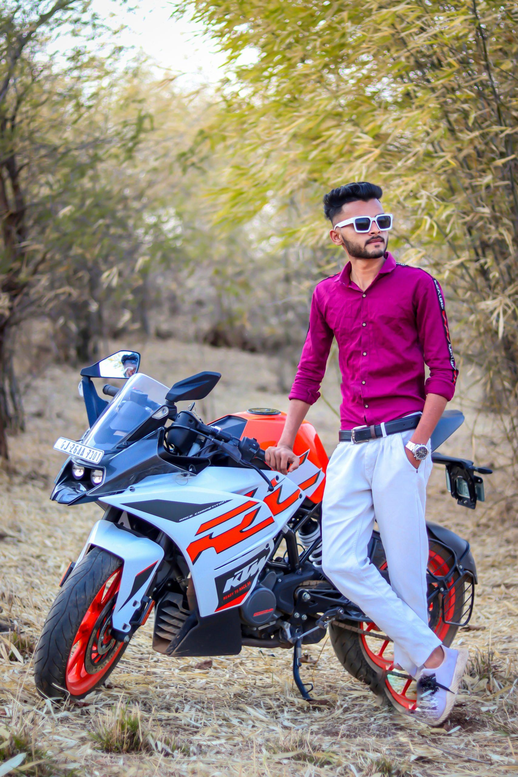 Boy posing near KTM bike