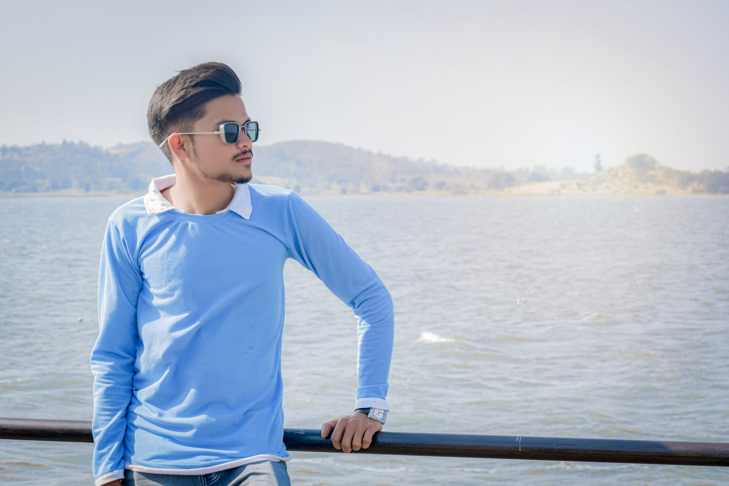 Boy posing near the river