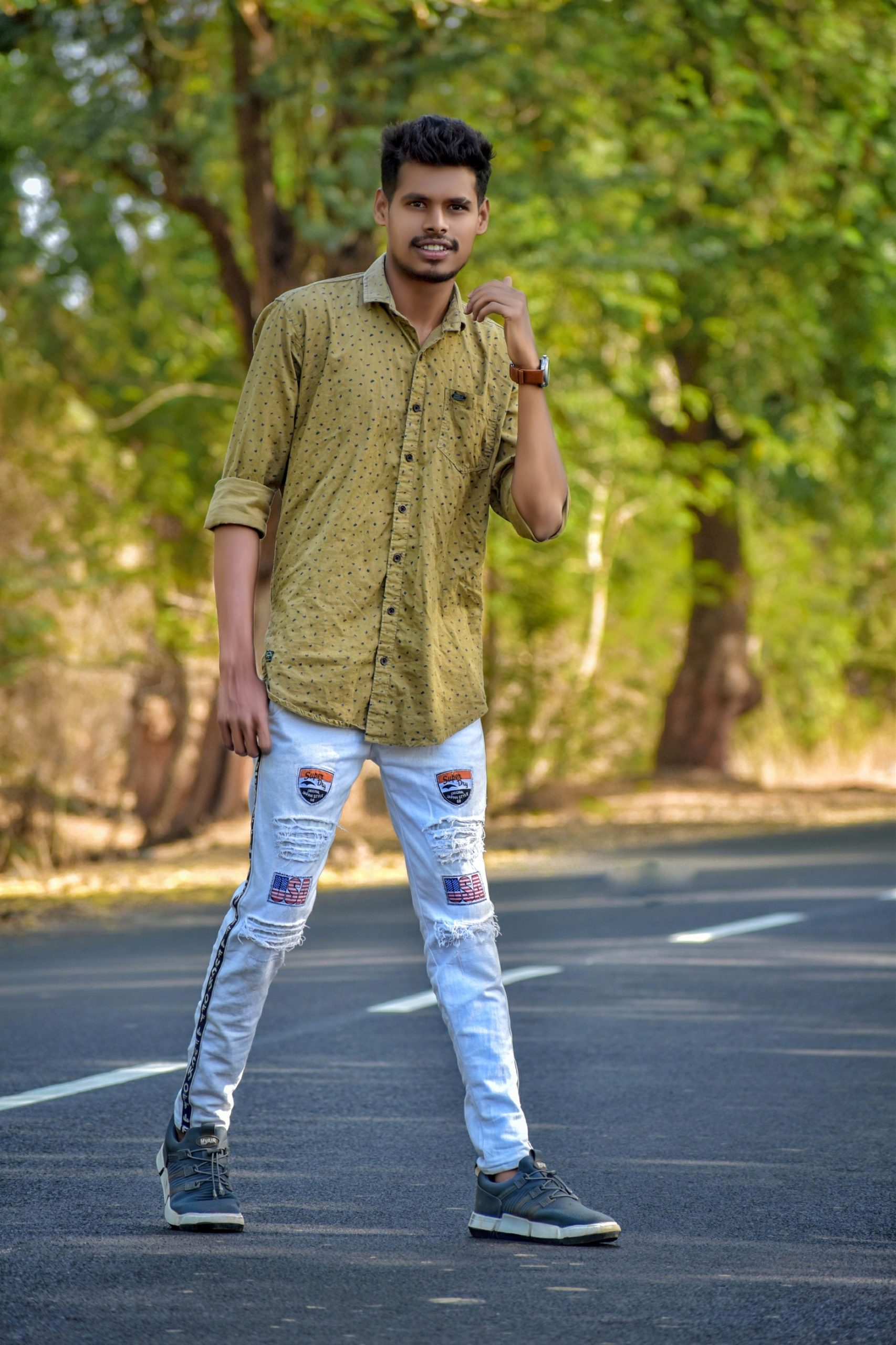 Boy posing on road