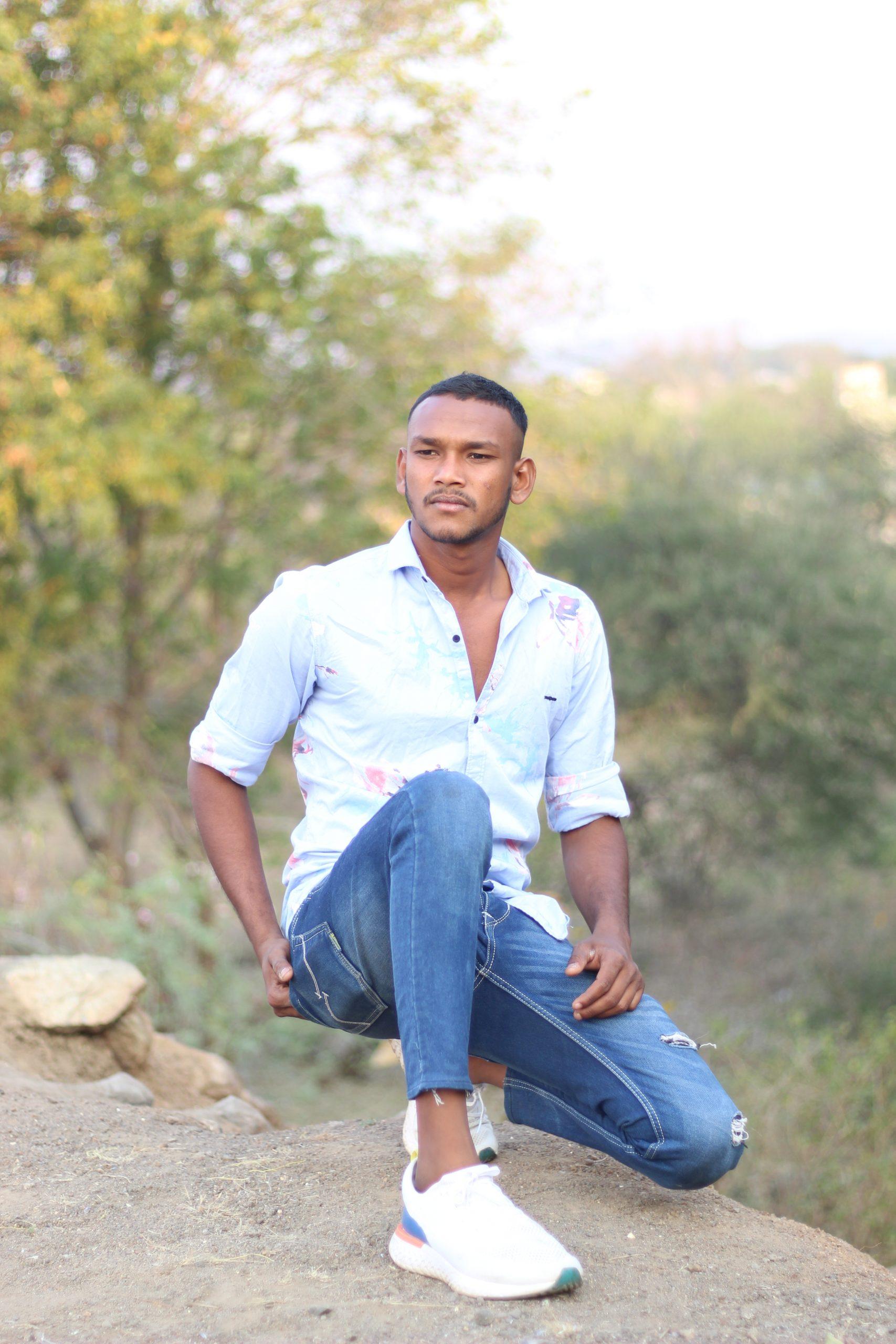 Boy posing while sitting in the farm