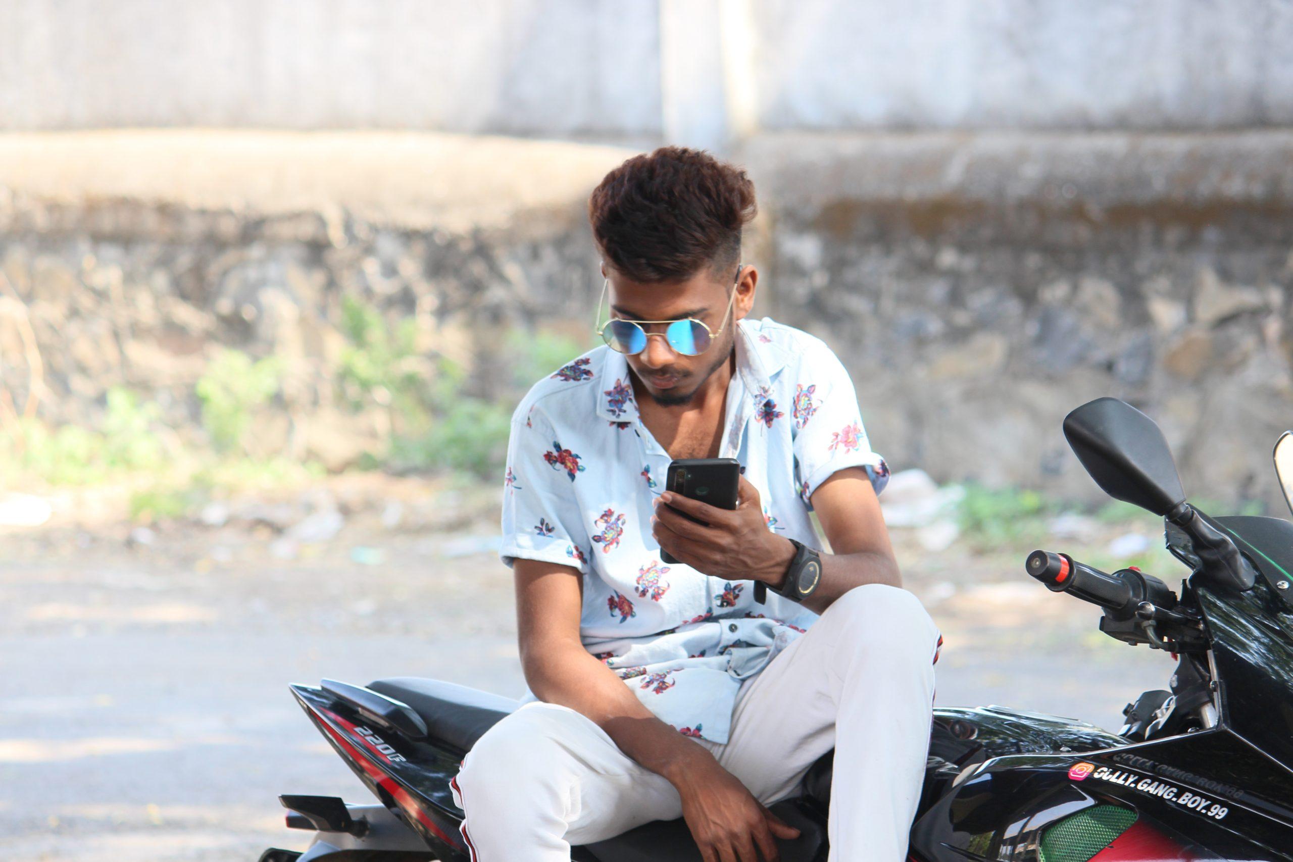 Boy posing while sitting on the Bike