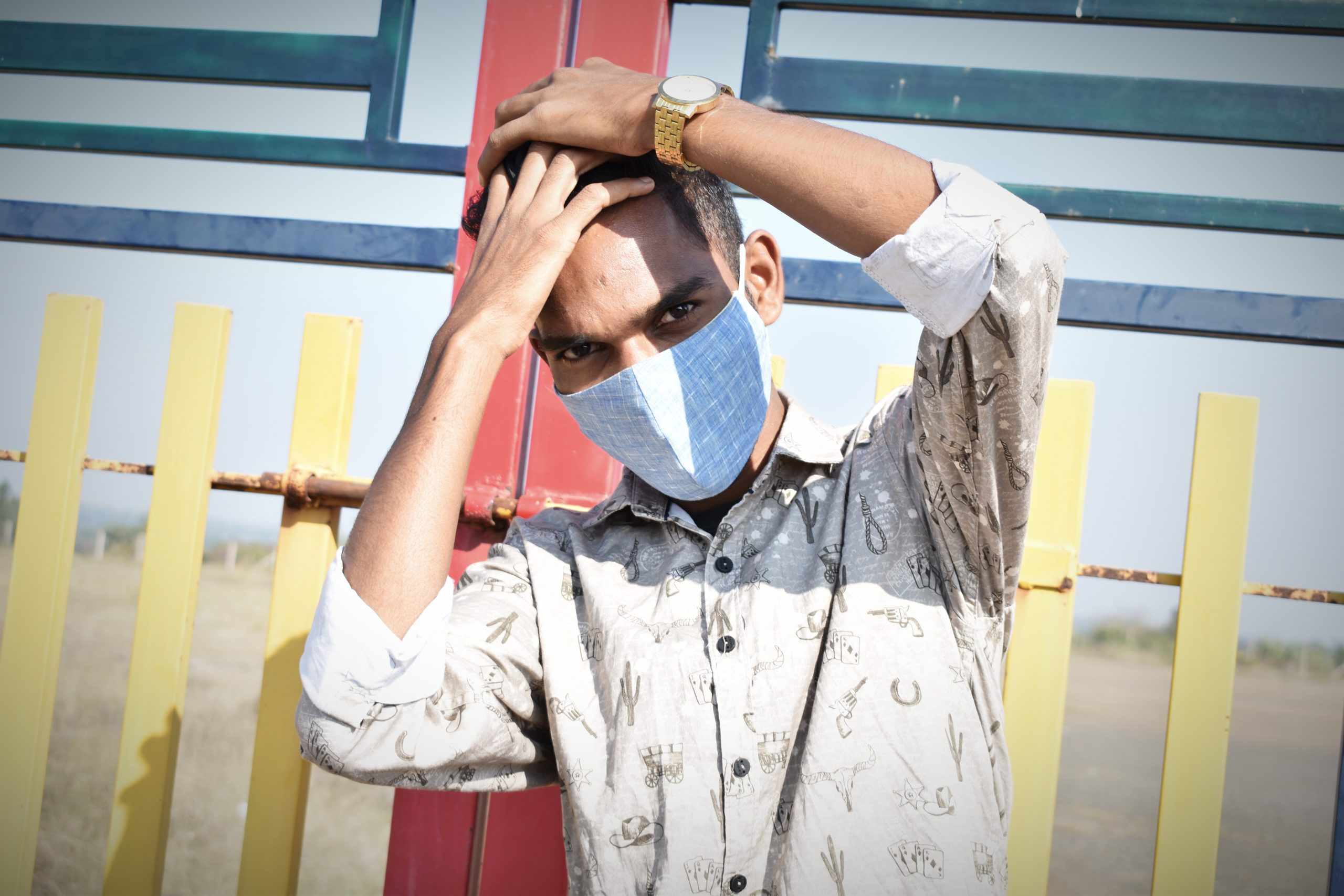 Boy posing while wearing facemask