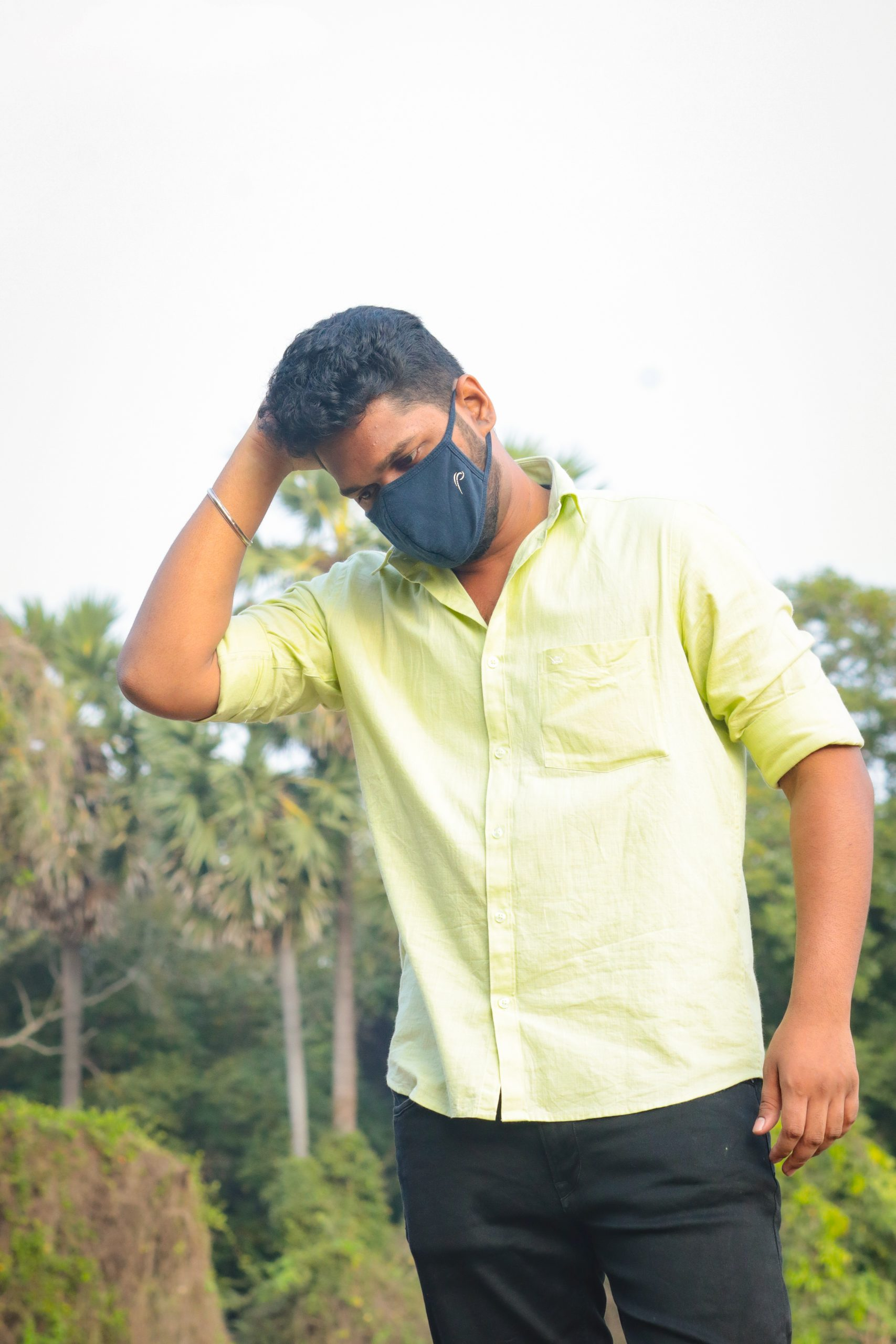 Boy posing with facemask