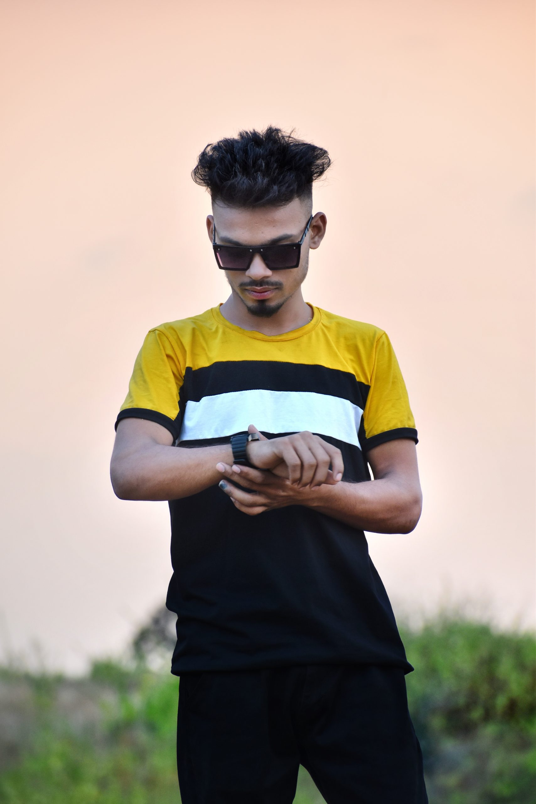 Boy posing with watch