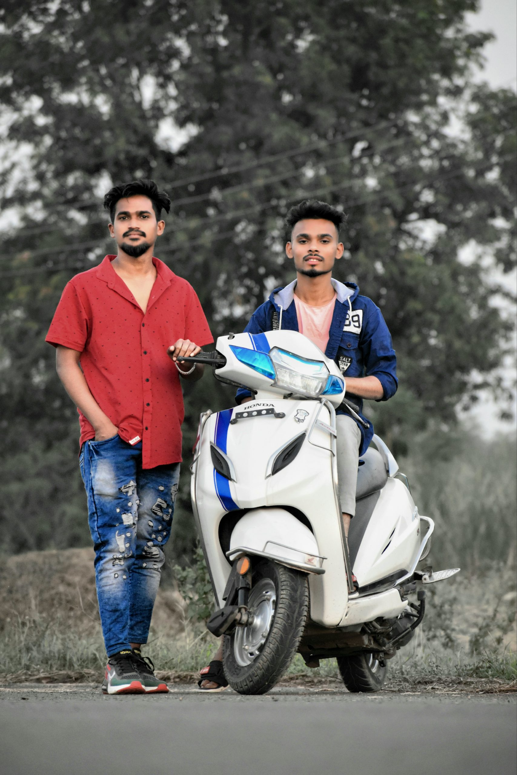 Boys posing on scooty