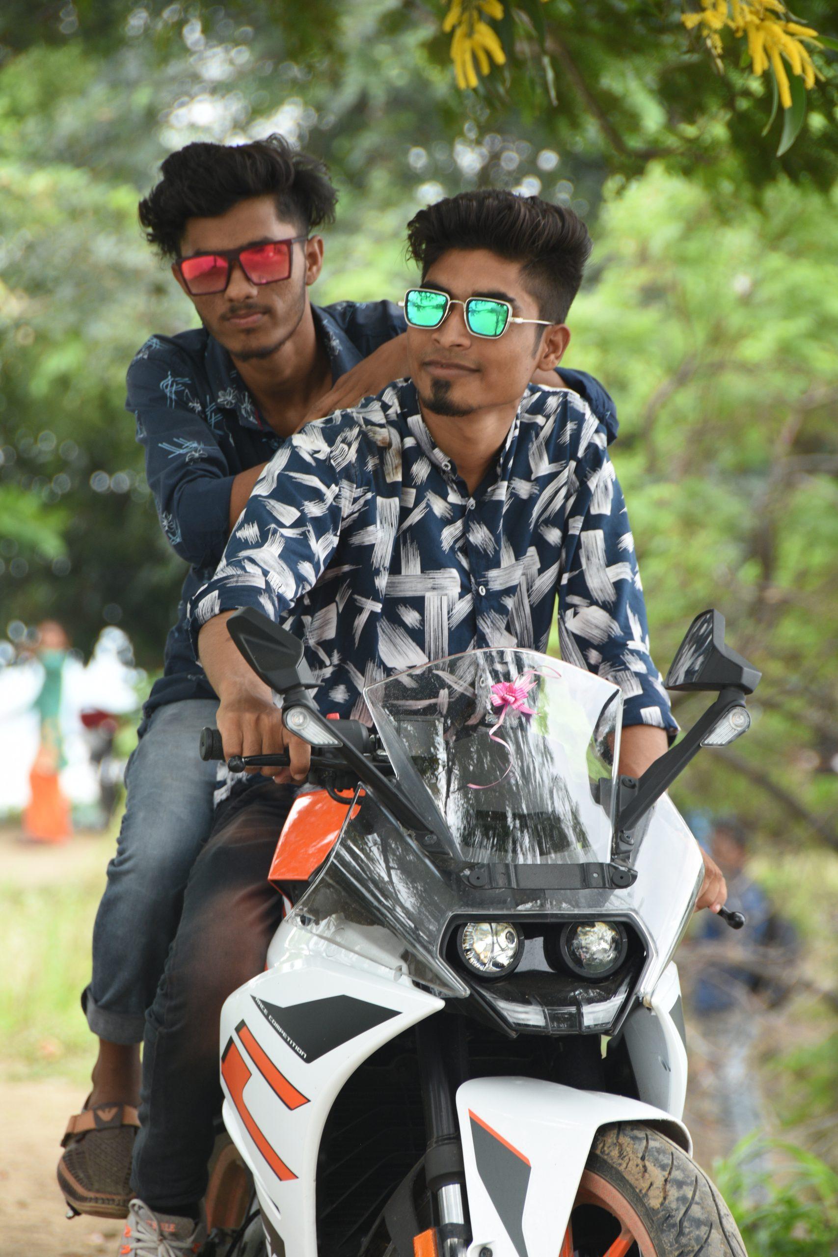 Boys riding on a bike