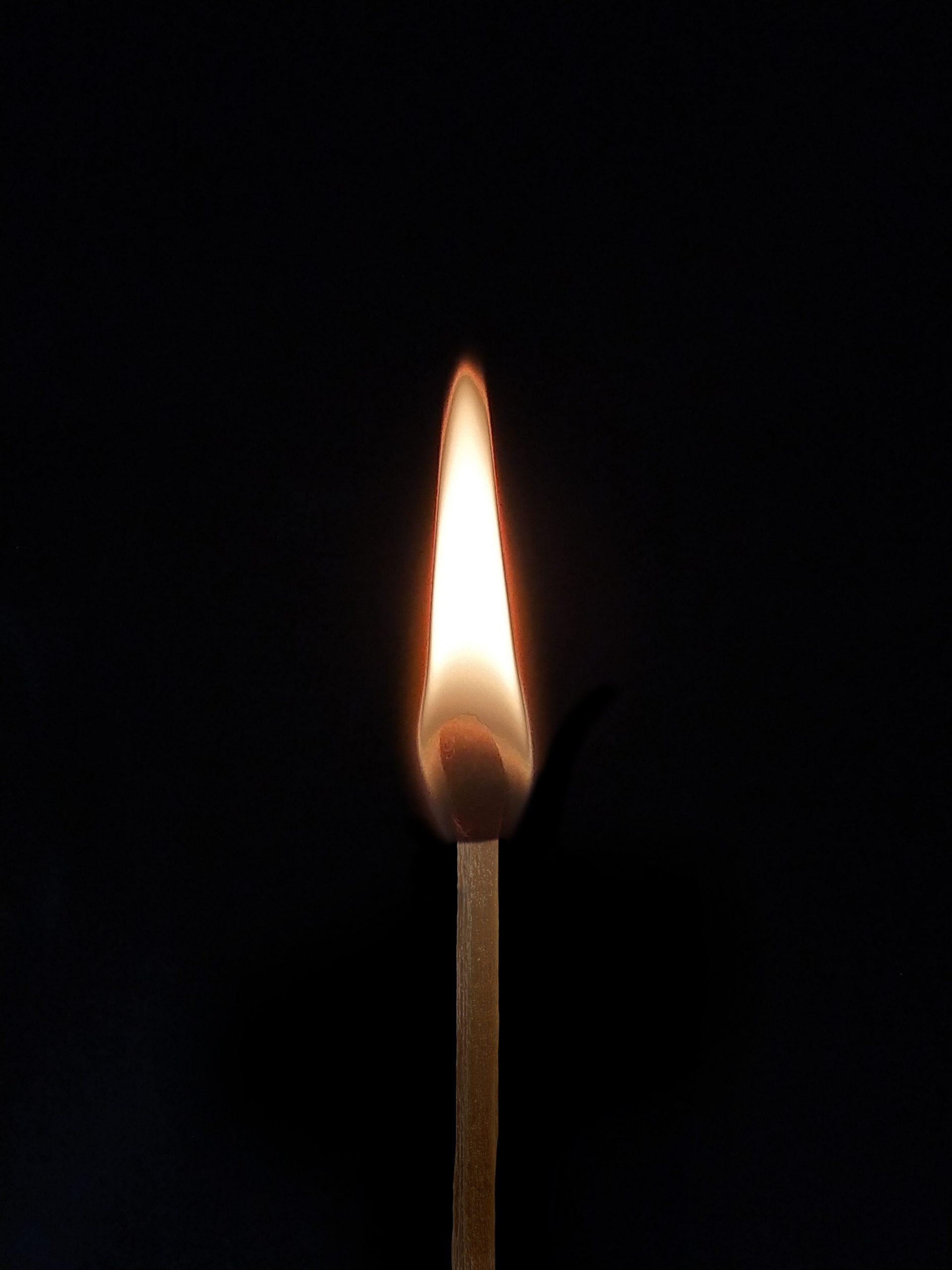 Burning match stick