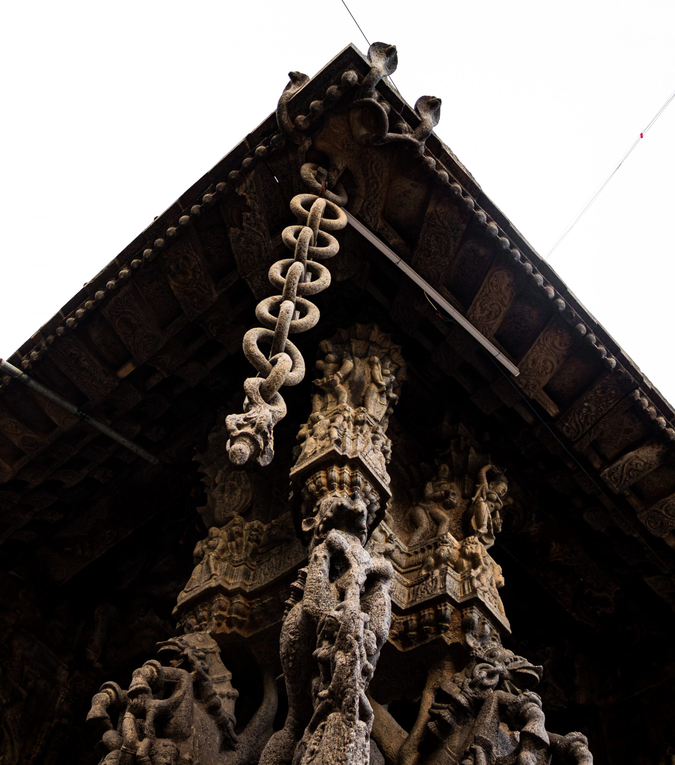 Chain and temple statue under tin shade