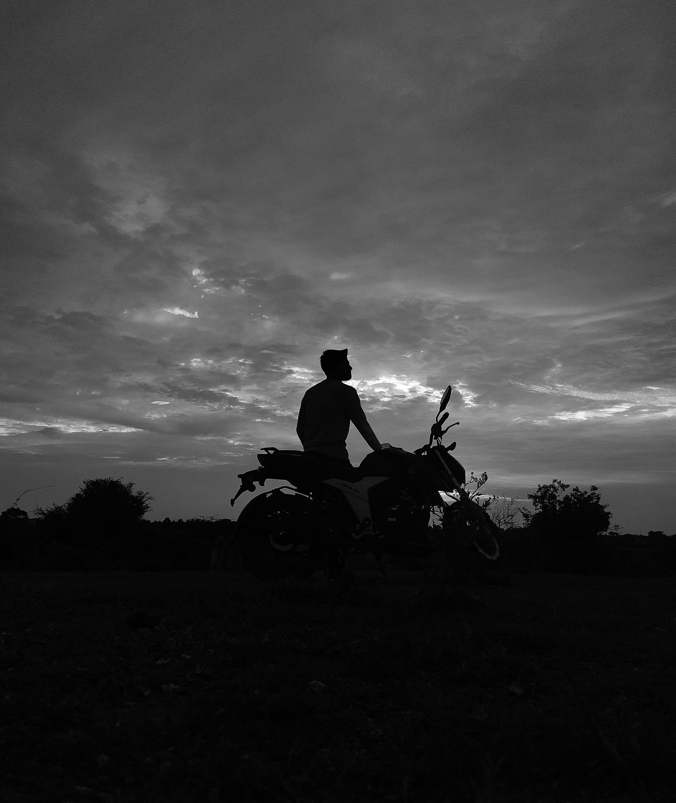 Clouds and a bike rider