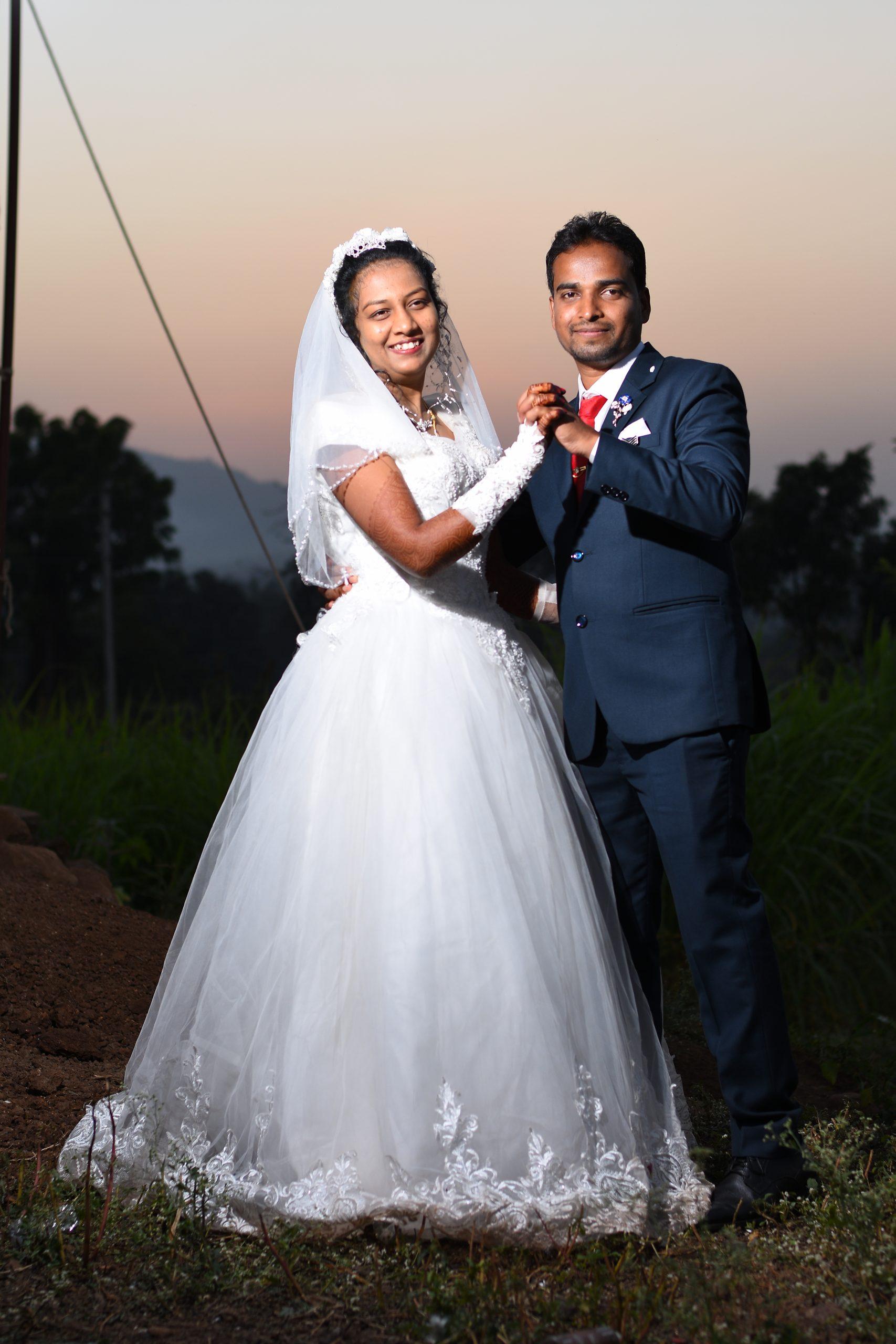 Christian couple posing on the wedding
