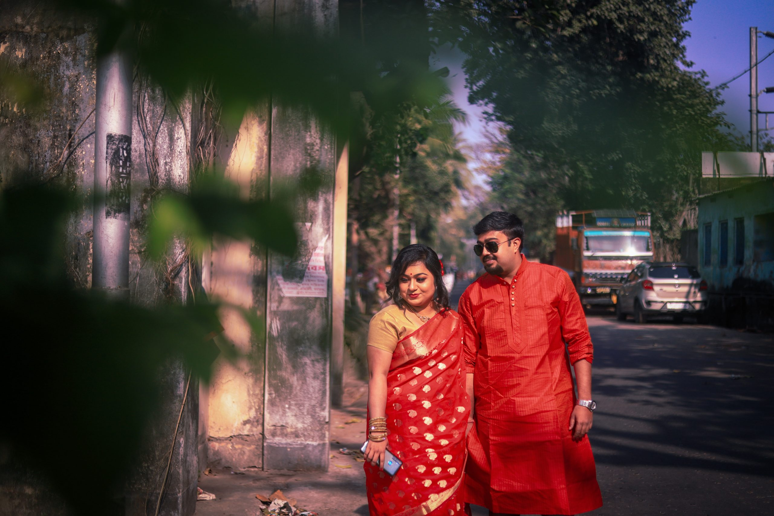 Couple posing road side