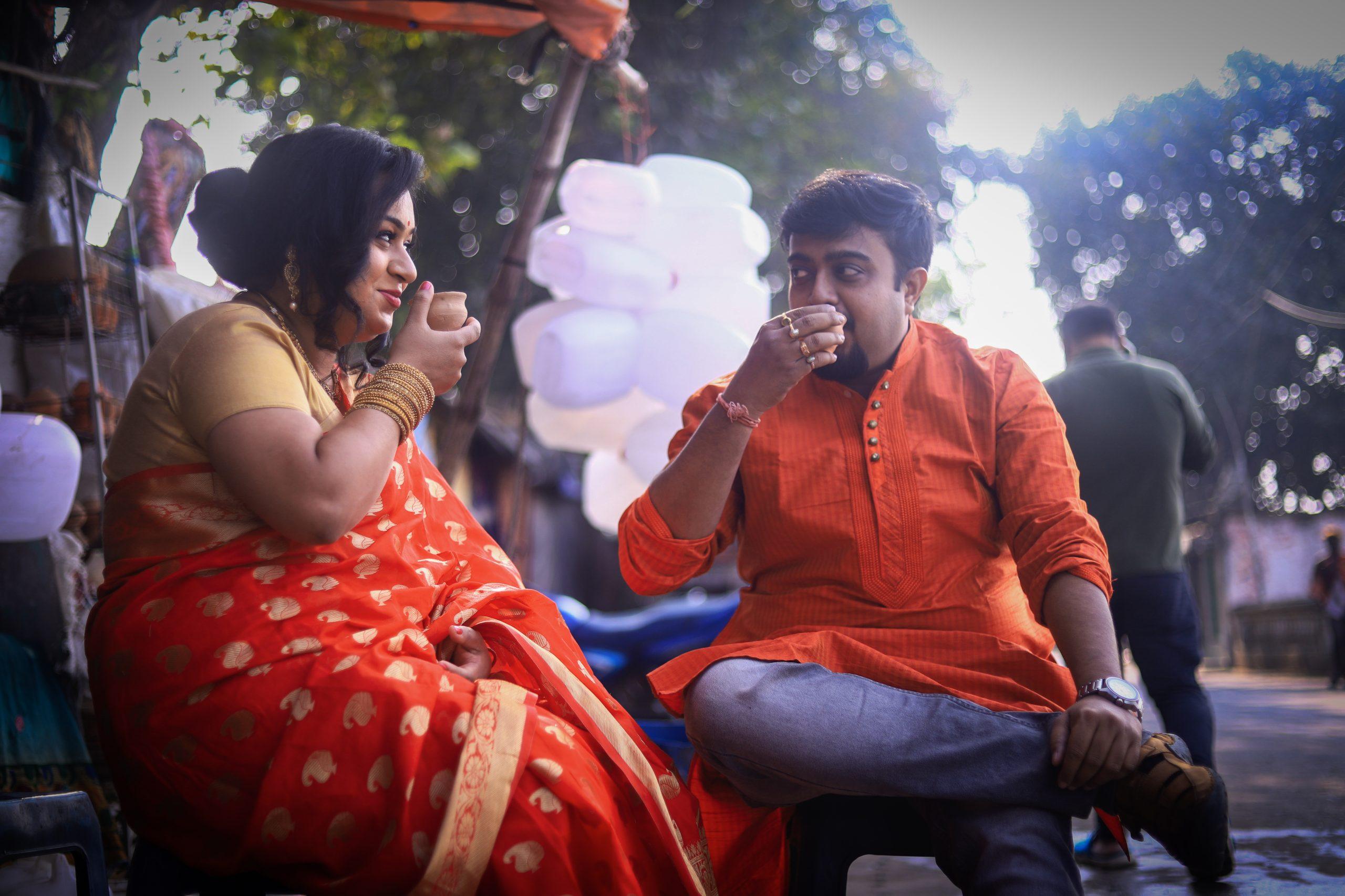 A couple having tea on a stall