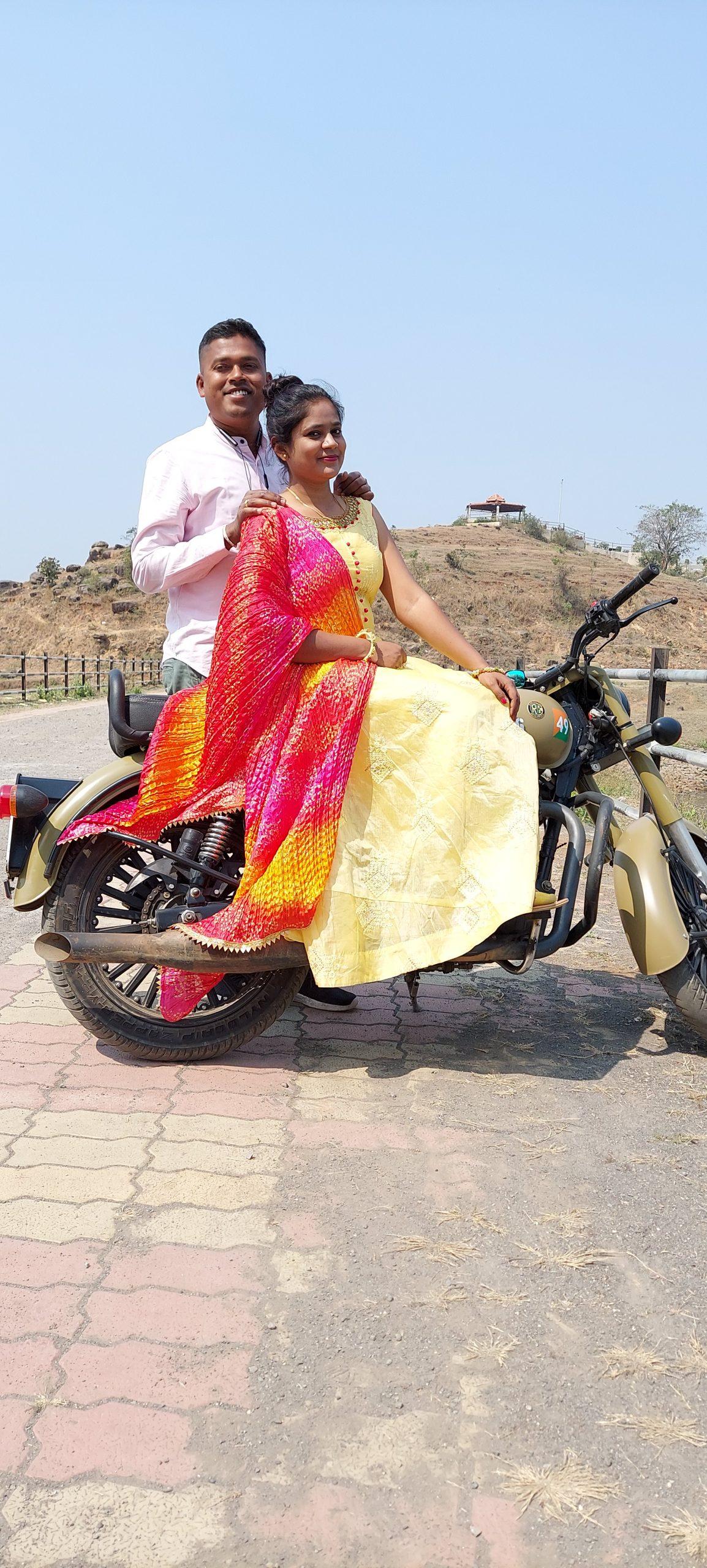 Couple posing on Royal Enfield bike