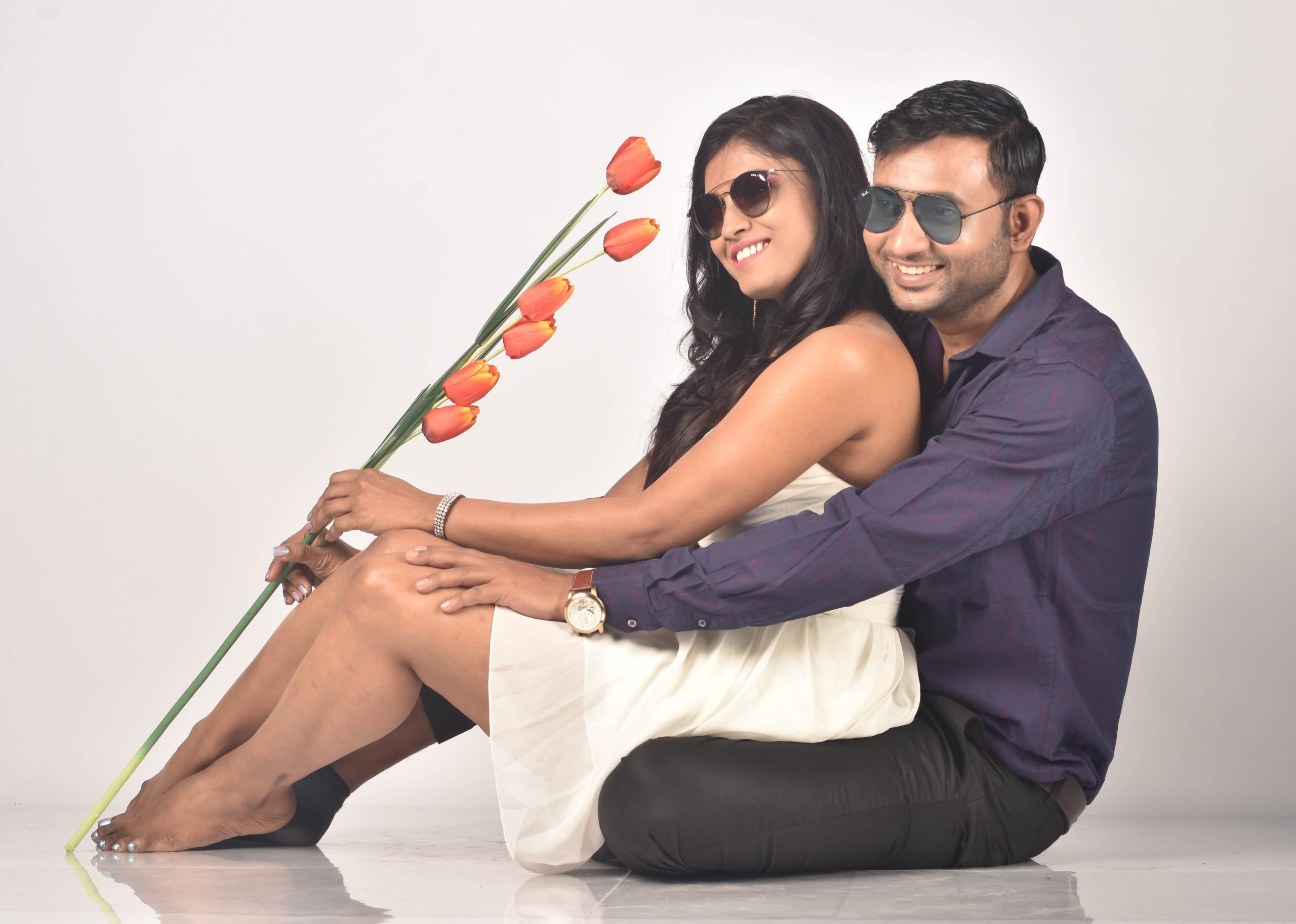 Couple posing with flower