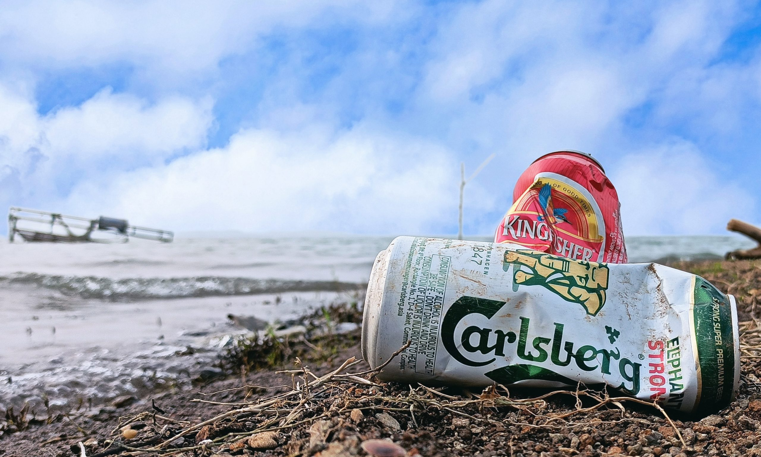 Empty beer can on a beach