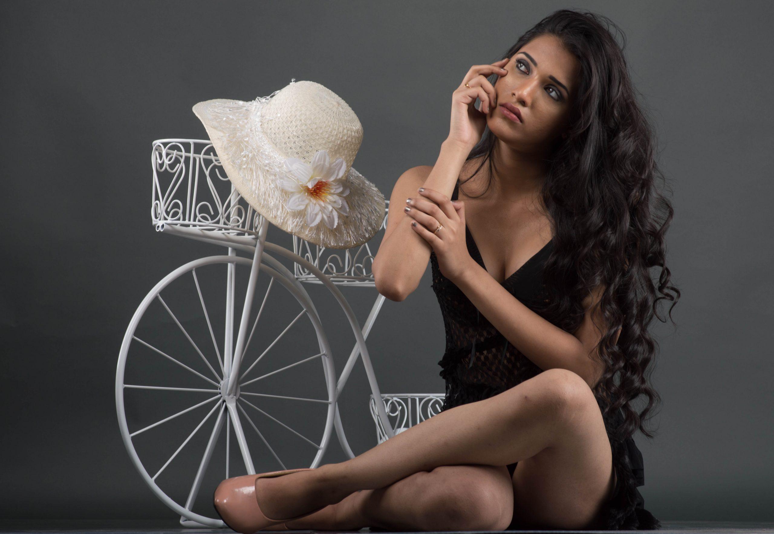 Female model posing near the cycle
