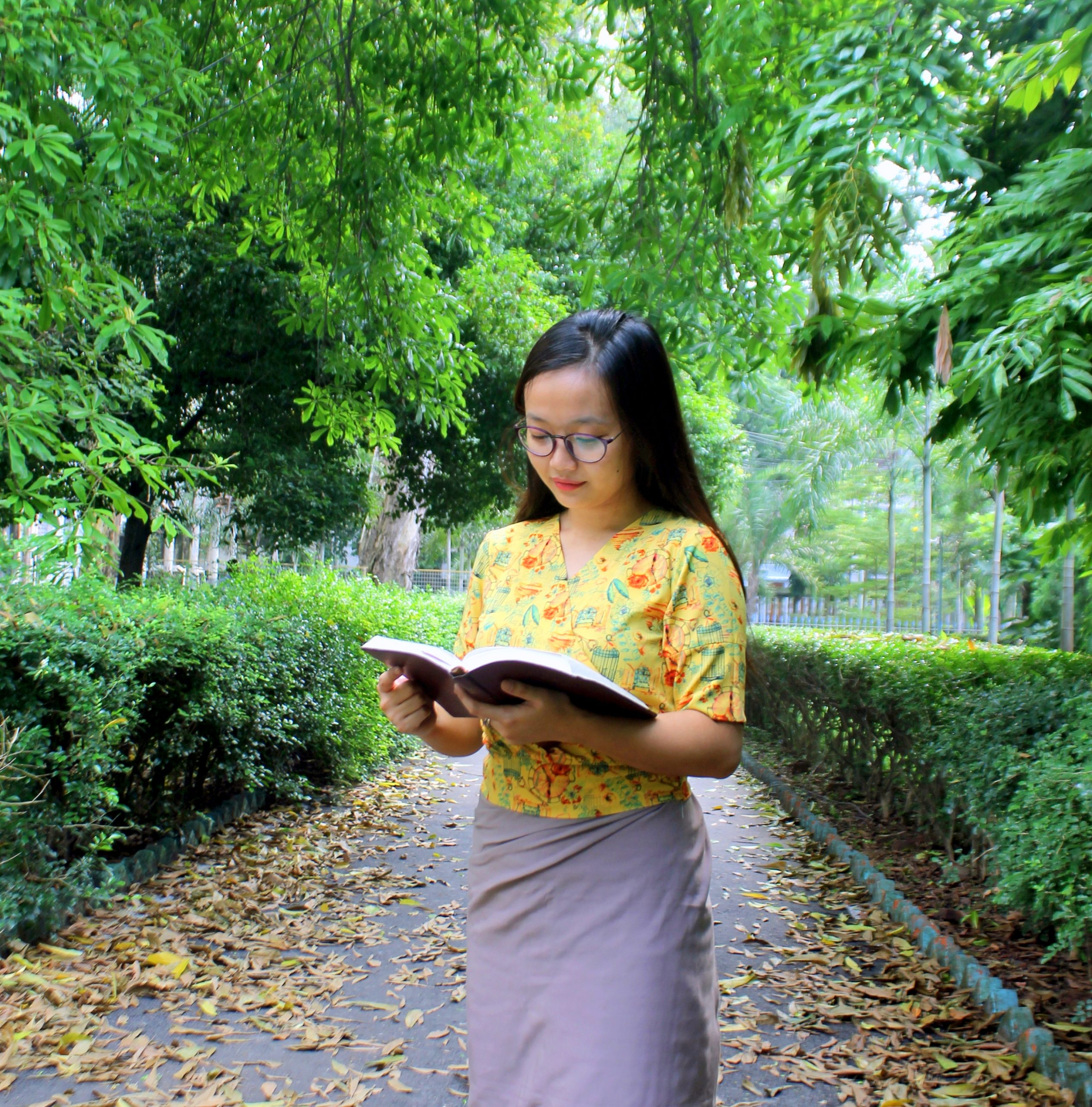 Girl Reading book in the garden