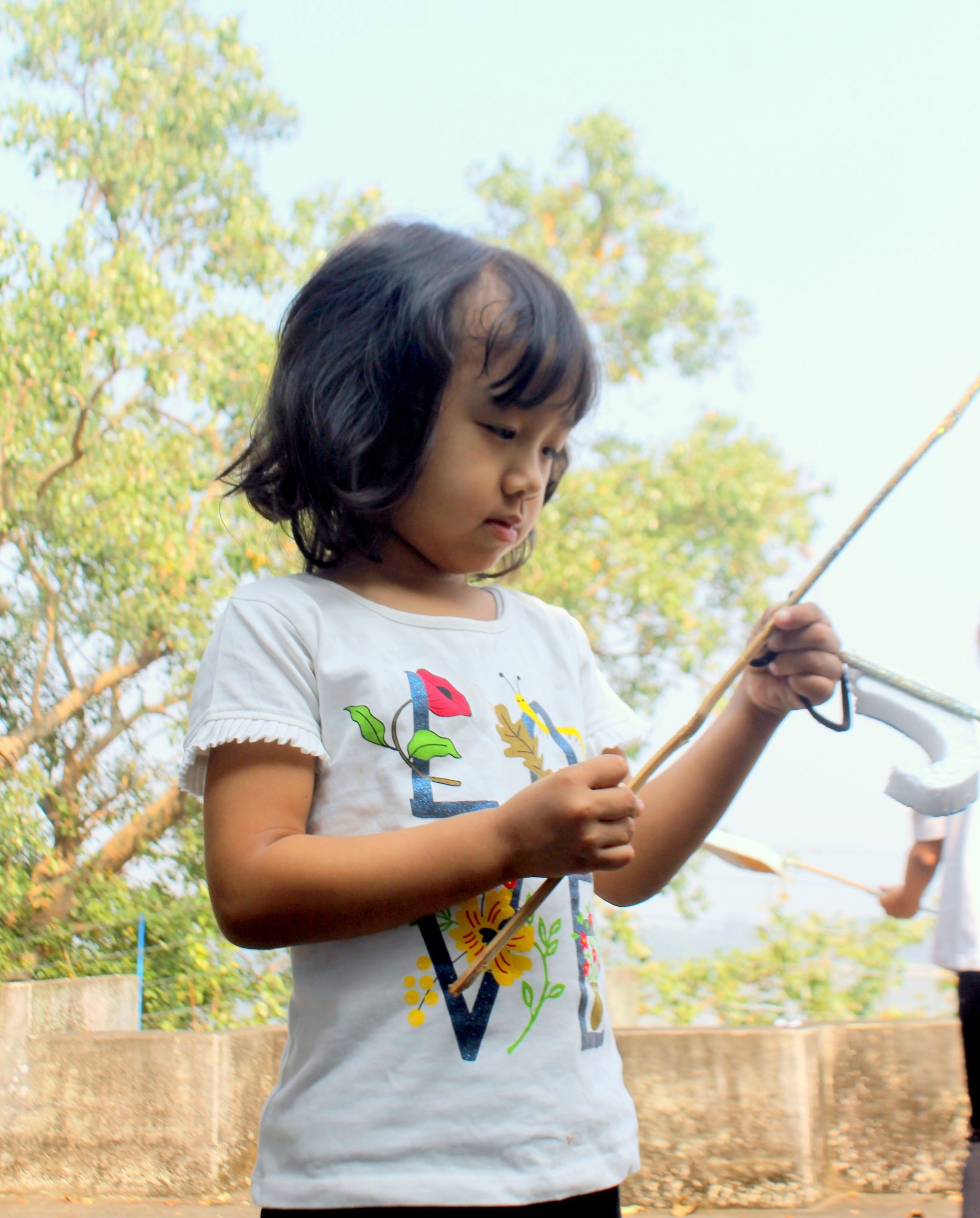 Girl with wood stick