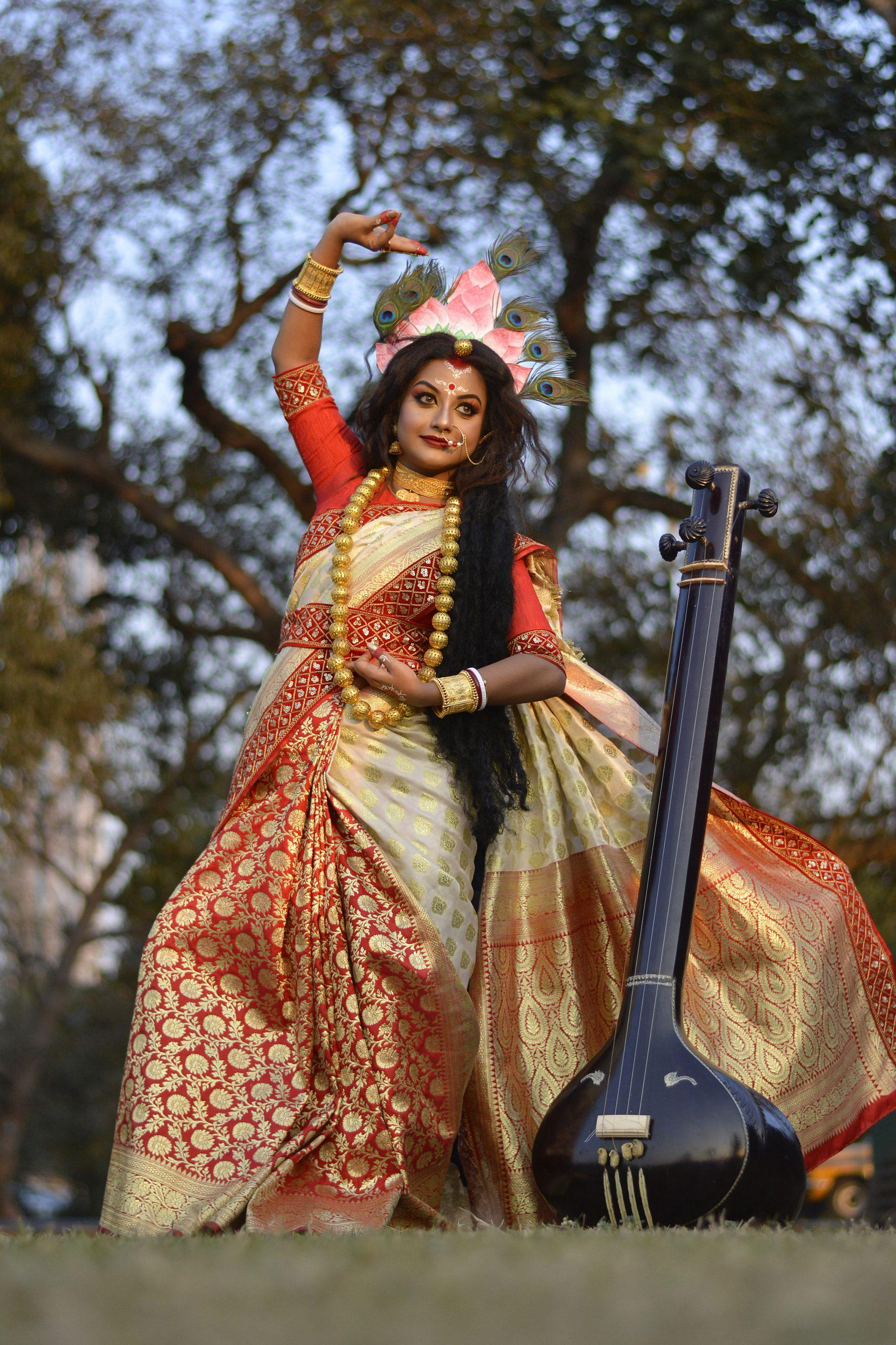Goddess Sarasvati posture done by a woman