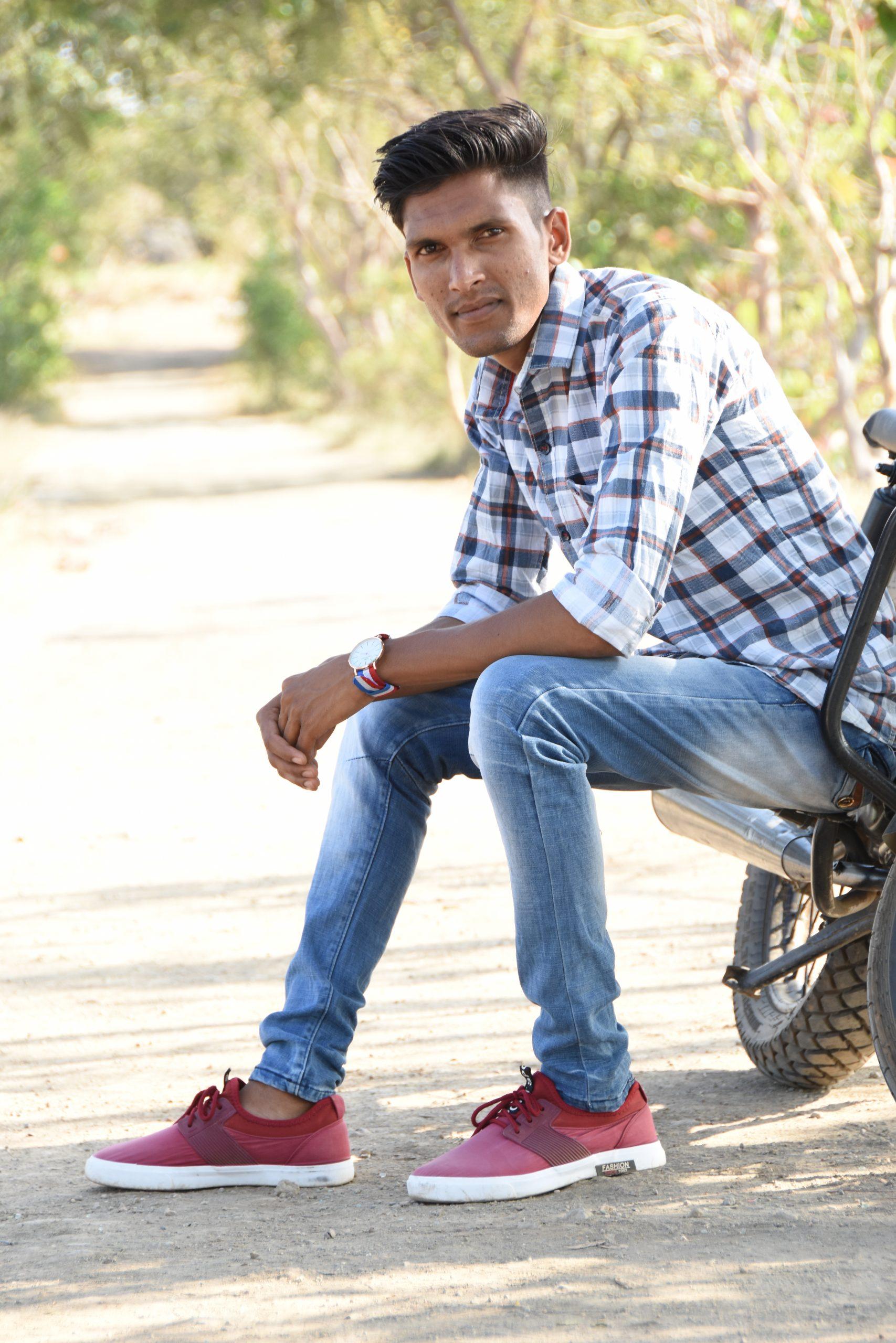 Boy posing on road
