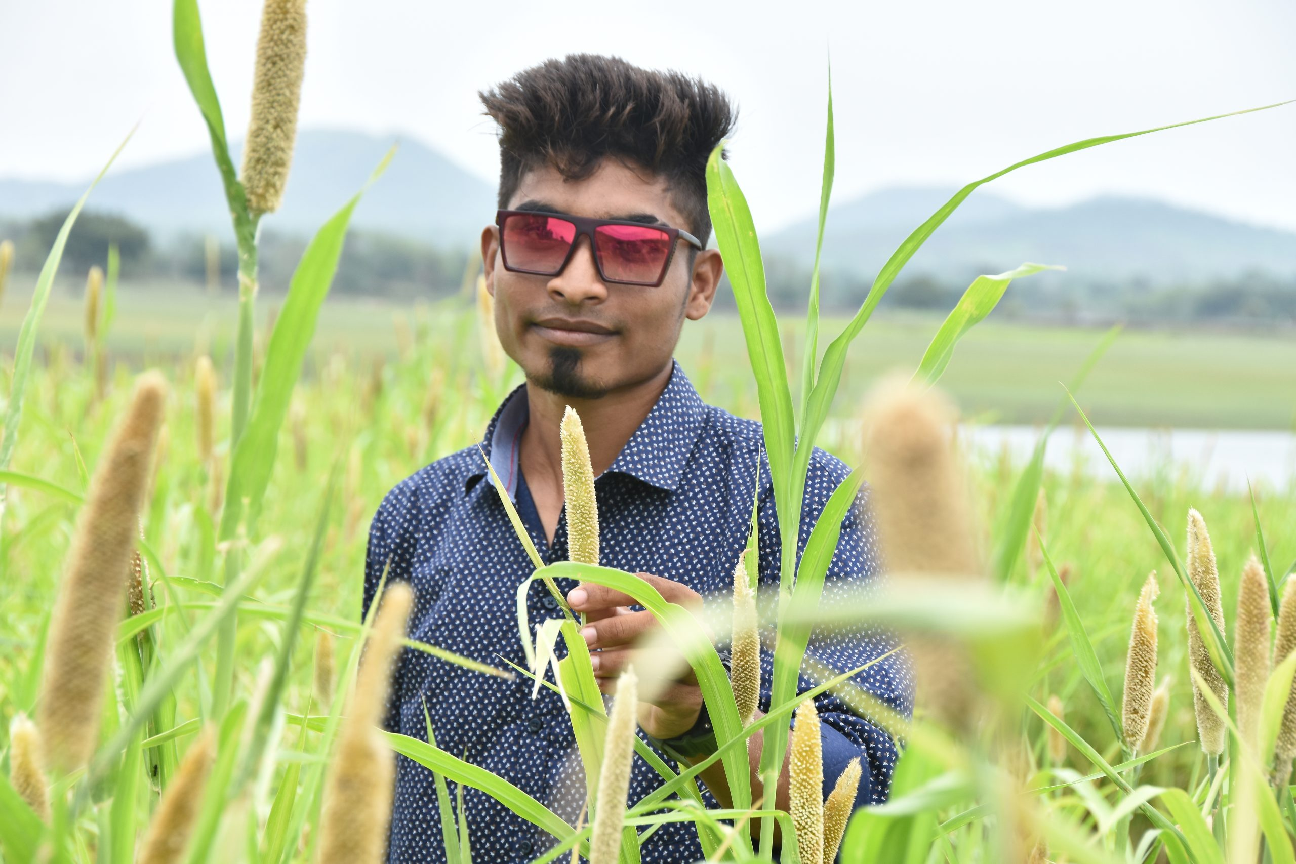 Boy in the farm and posing with sunglasses