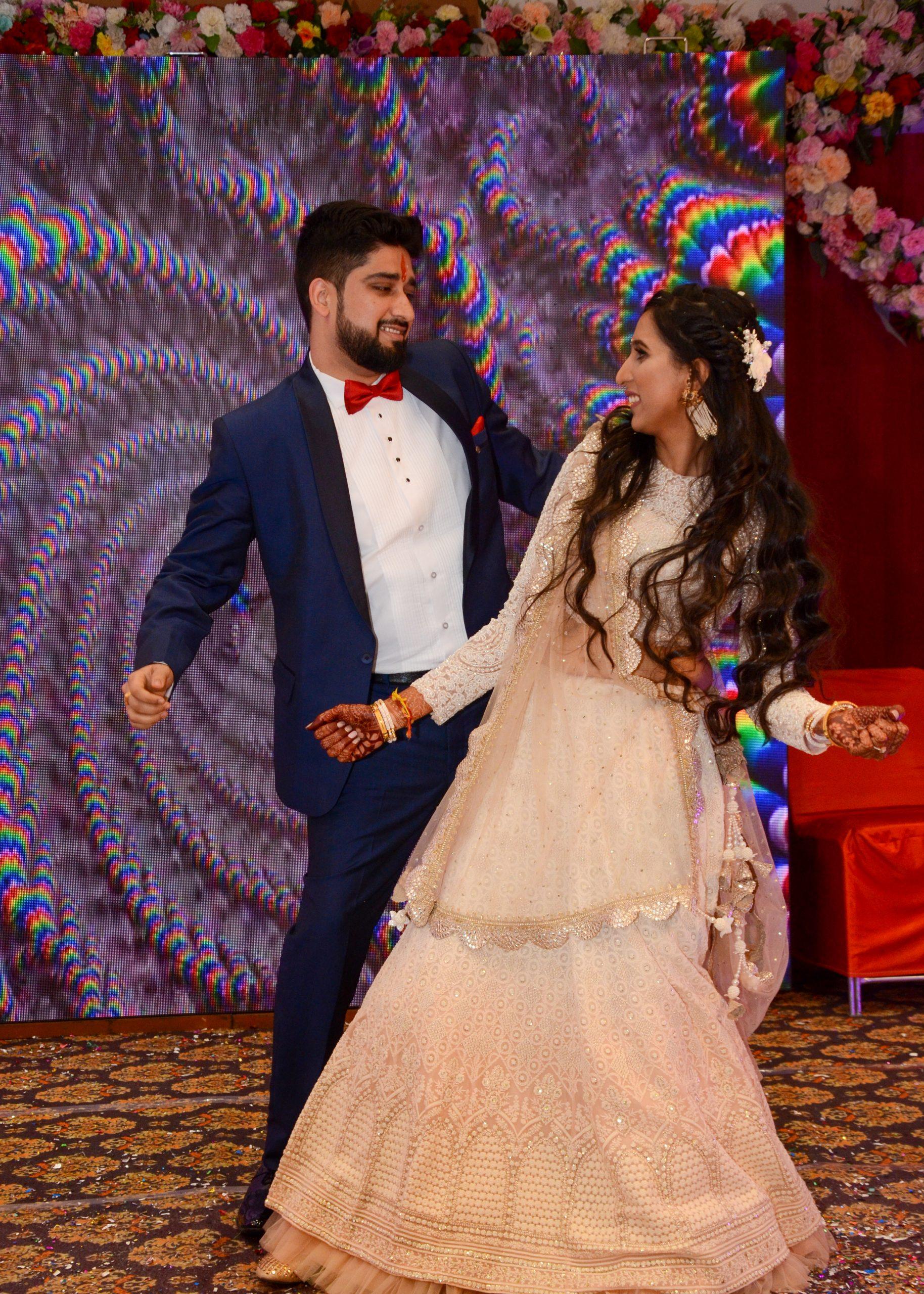 Indian couple dancing on wedding