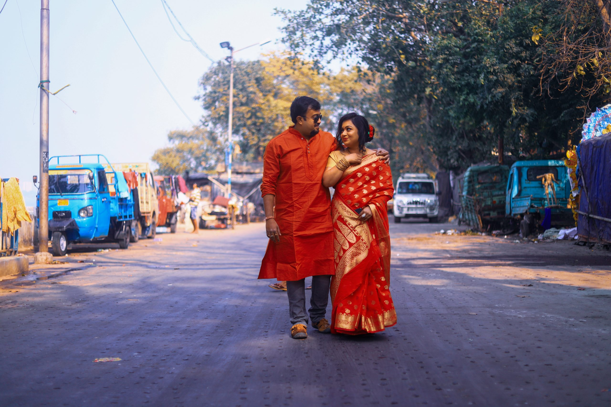 A married couple walking on a road