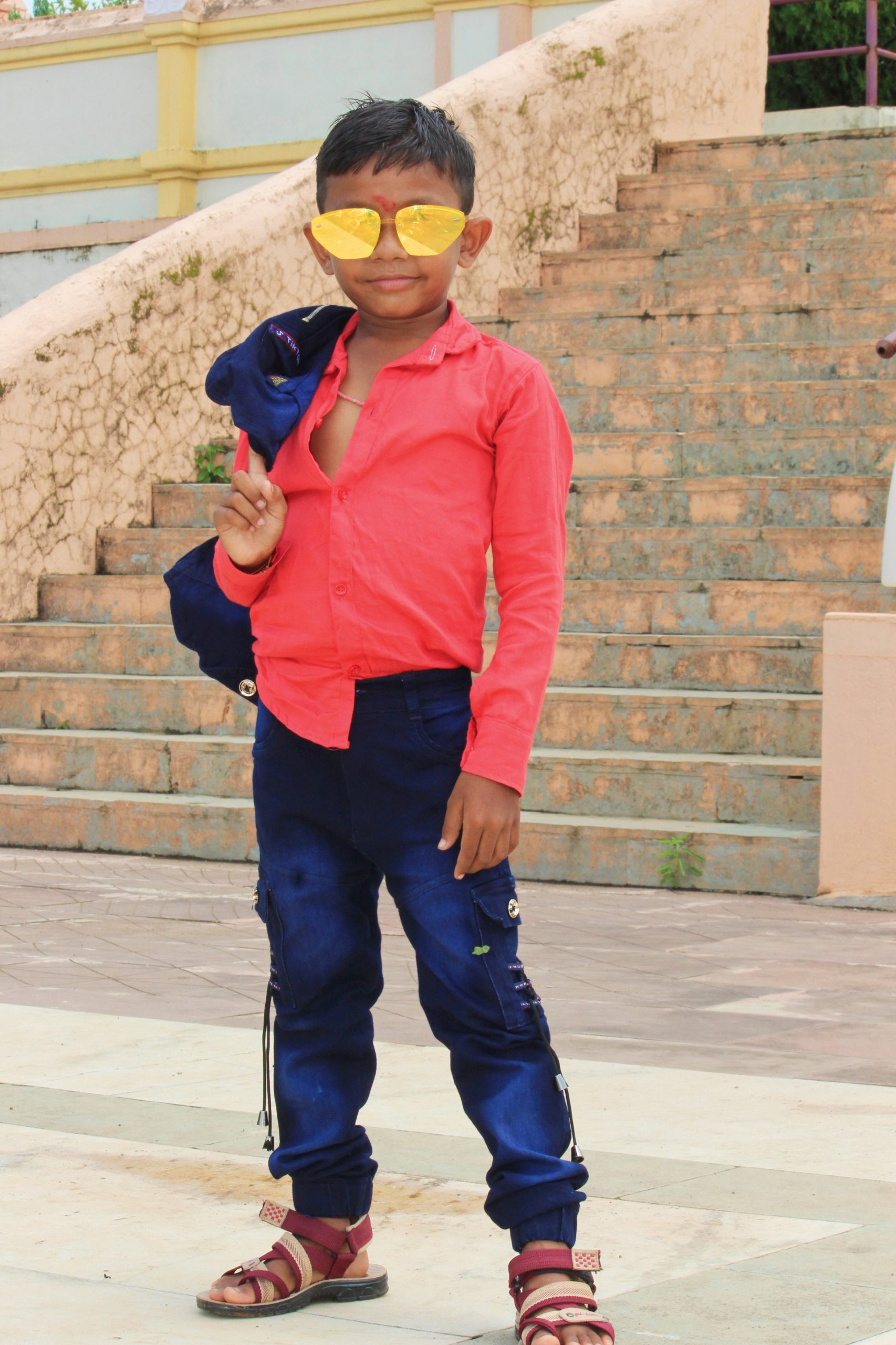 Little boy posing while wearing sunglasses