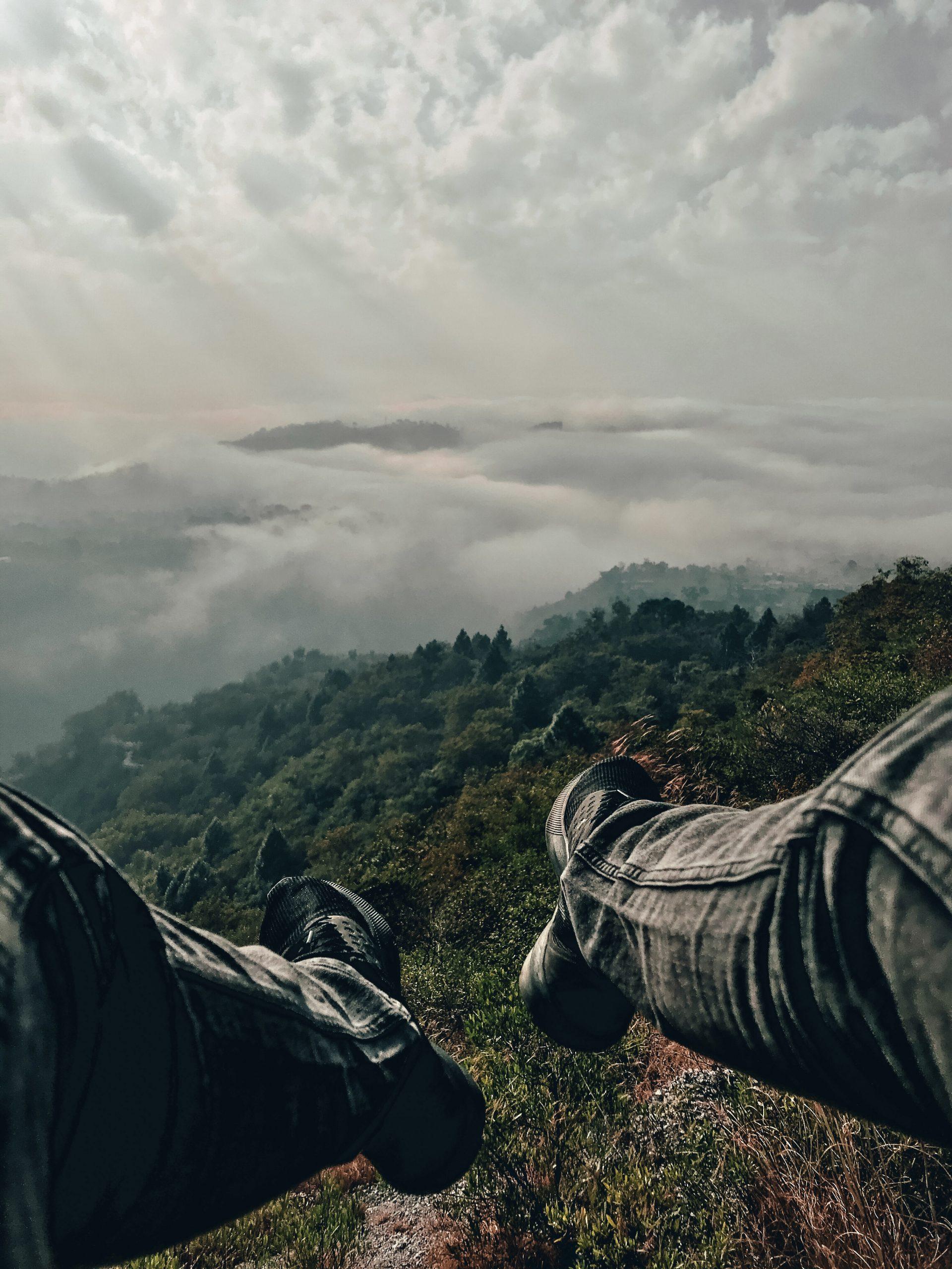 Man on the edge of mountain