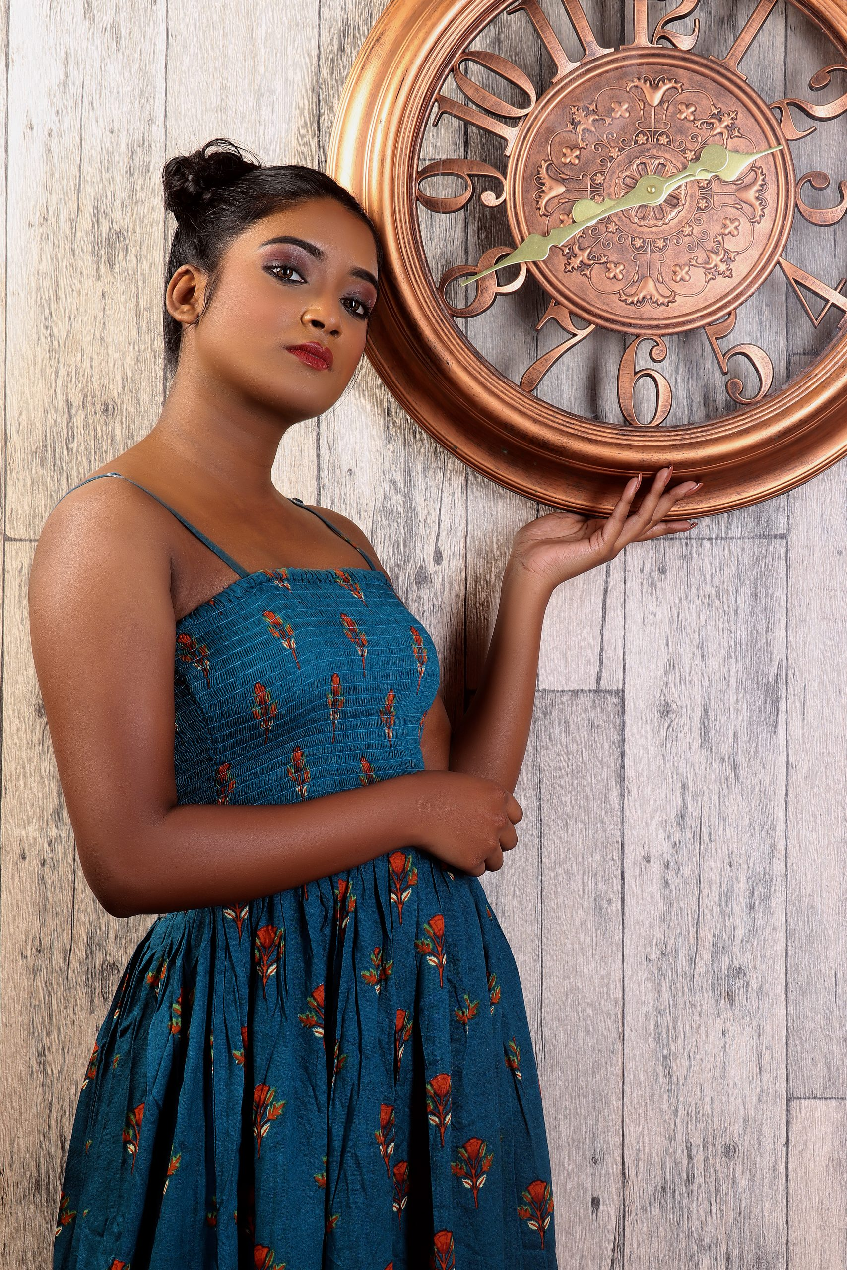 A girl near a wall clock