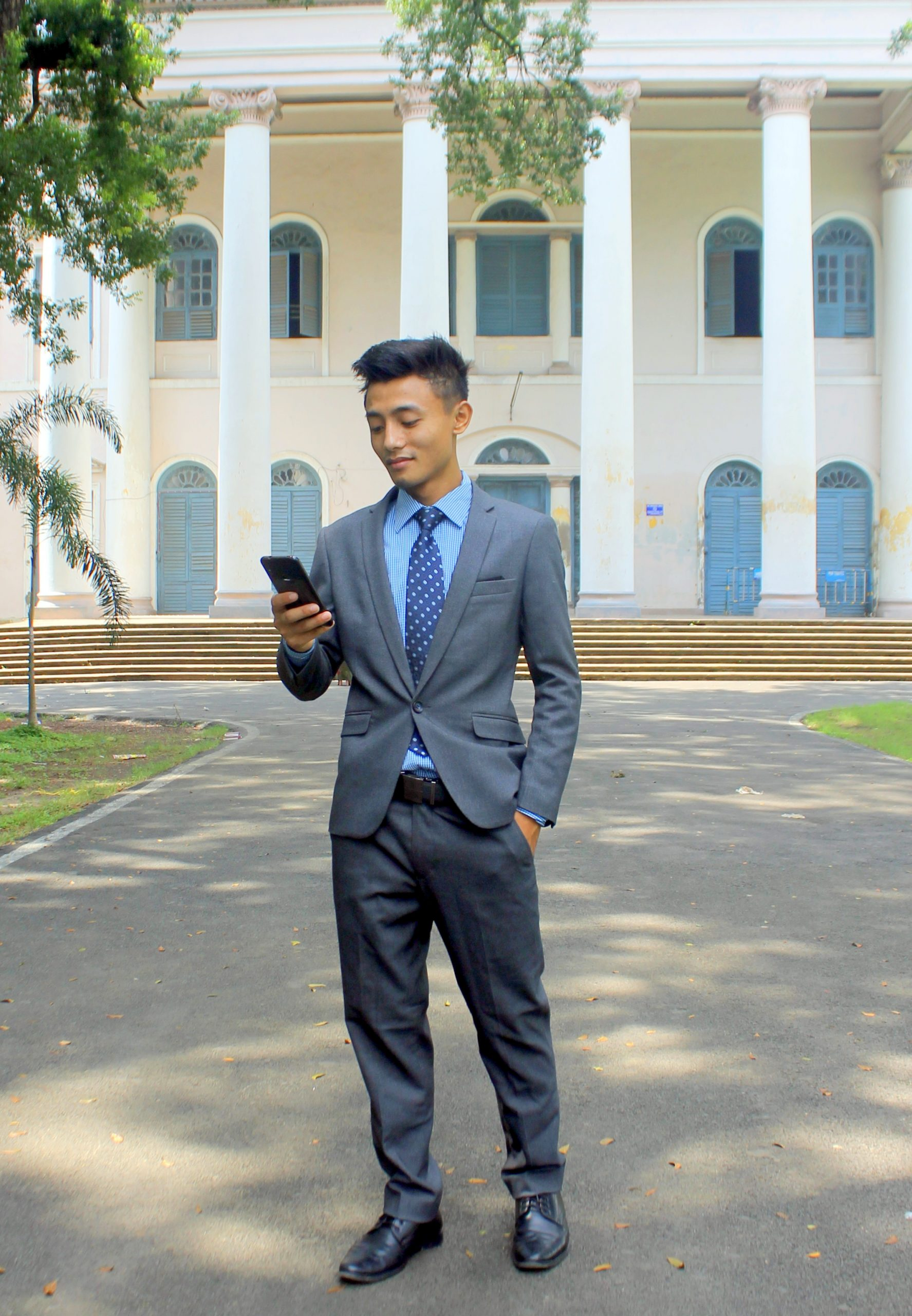 Male model posing in formal dress