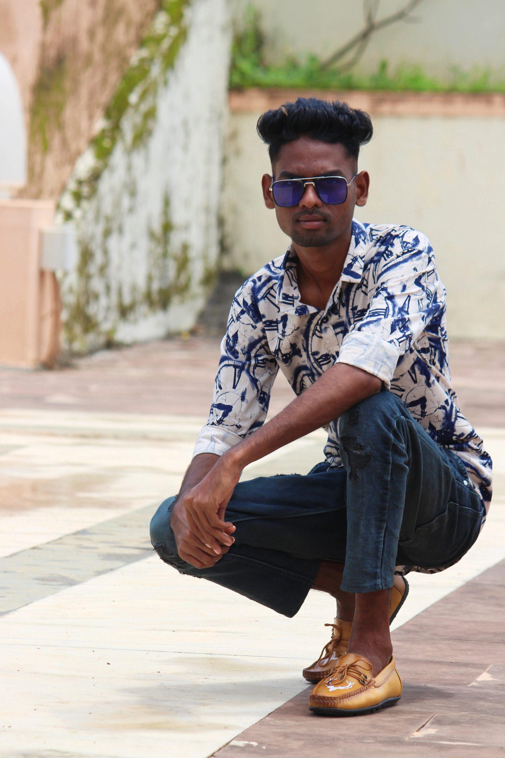 Male Model posing on road