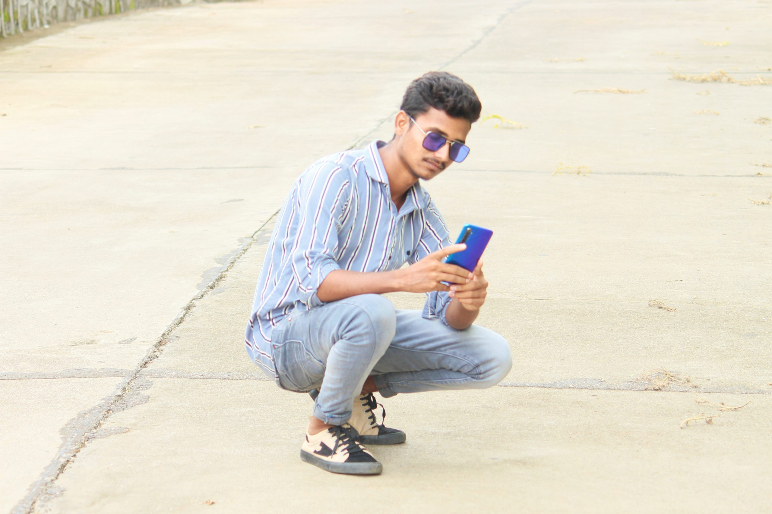 Male Model posing while mobile in his hand